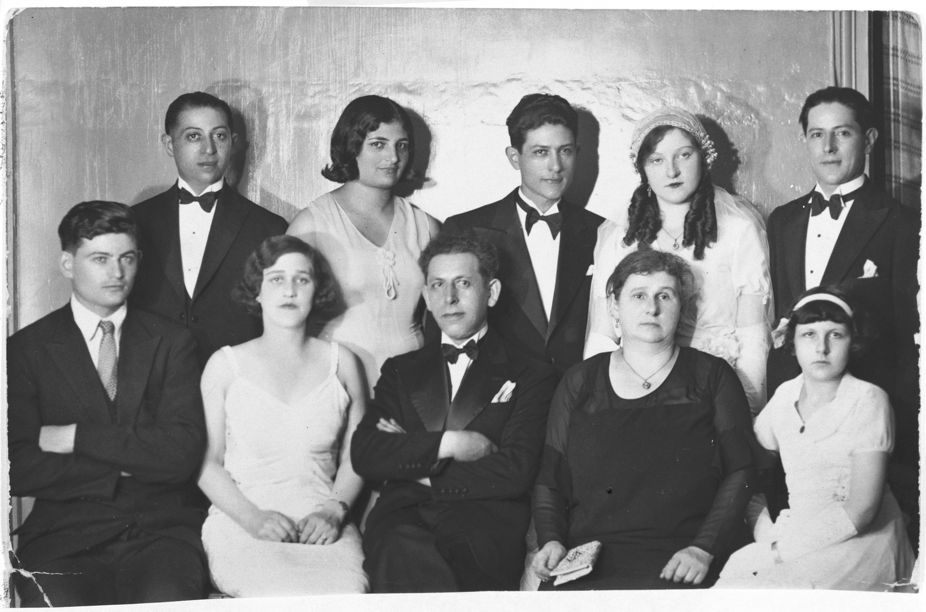 Wedding portrait of Bezalel Hershkovitz and Rosette Reisman.  Seated left to right are Izhak Amitai, Ray Hershkovitz, Koppel Grunbaum, Sarah Welner-Reisman-Grunbaum, Suzanne Reisman,  Standing are Harry Hershkovitz, Esther Amitai, Bezalel Hershkovitz, Rosette Hershkovitz and Gavriel Hershkovitz.