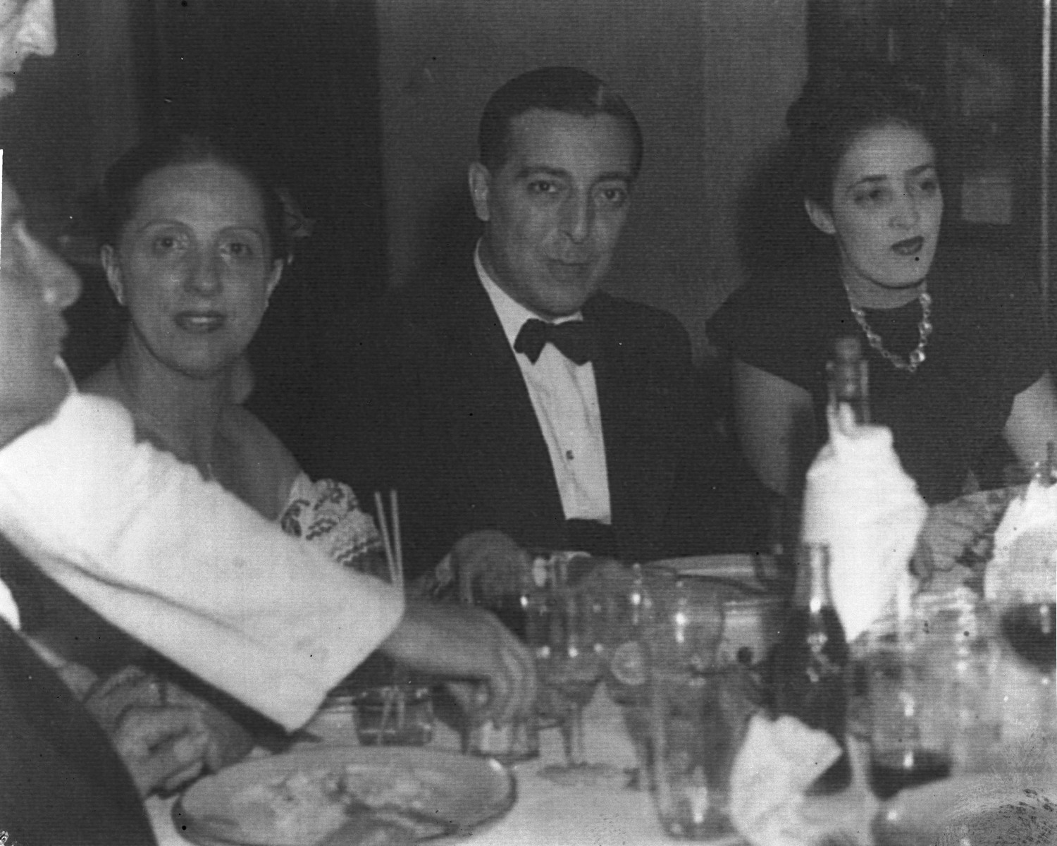 Portuguese diplomat Carlos de Liz-Texeira Branquinho at a dinner party.