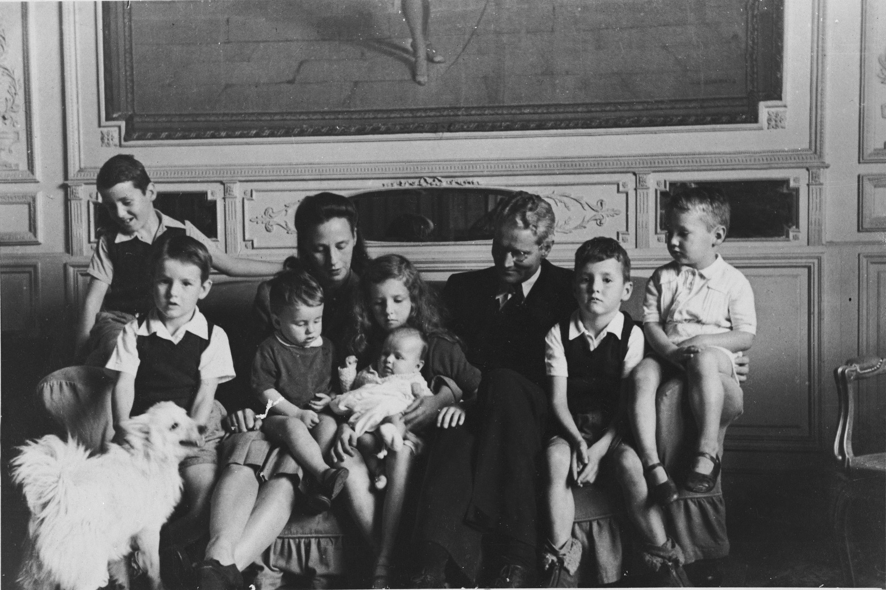 Vice Consul Hiram Bingham poses with his family at his residence in Buenos Aires, Argentina.  Pictured are Hiram and Rose Bingham with seven of their children.  The children are, from left to right: Hiram Anthony, John, Robert Kim, Rose Tiffany holding baby Maria Cecilia, Thomas and David.