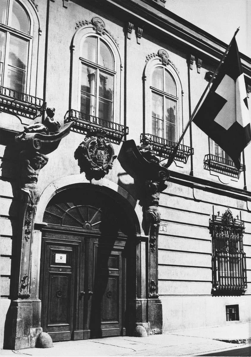 The Swiss flag hangs in front of the British Legation on Verbocsy Street in Budapest.
