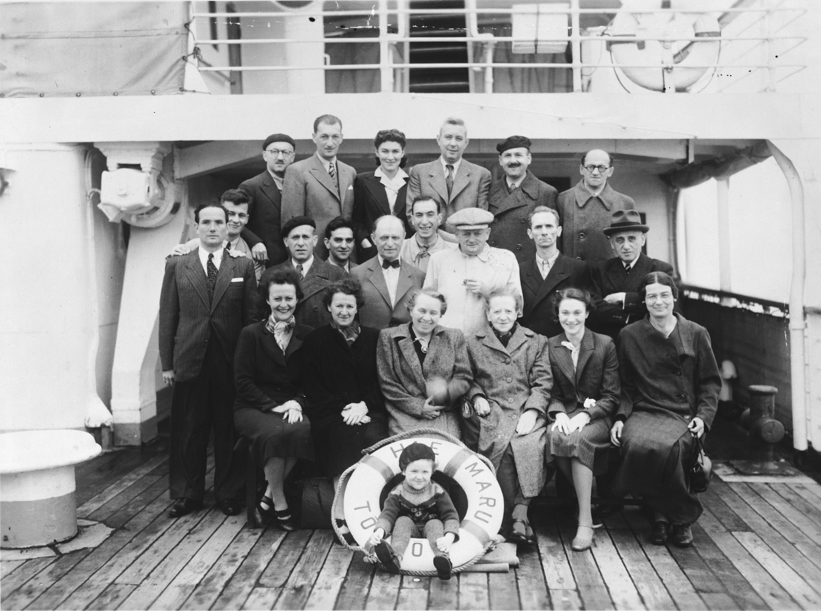 Group portrait of Jewish refugees on the deck of a Japanese ship while en route to the United States.  Among those pictured is Susan Berman (top row, center).  Some of these refugees reached Japan with the aid of Japanese transit visas issued by Chiune Sugihara, Consul for Japan in Kaunas, Lithuania in 1940.