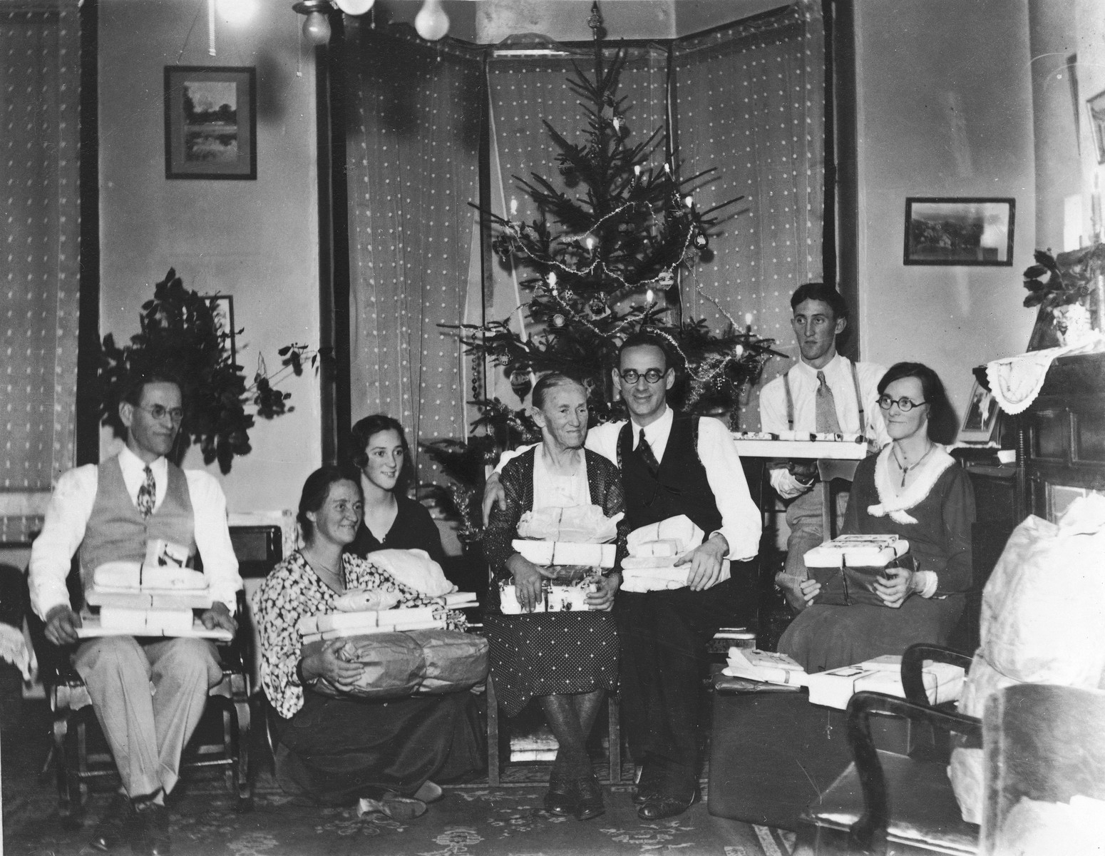 Consul Charles (Carl) Lutz (center, right) poses with his mother at a Christmas party.