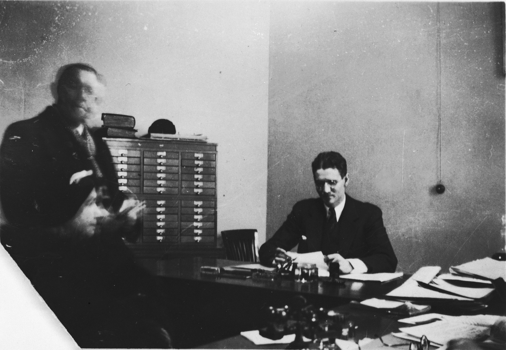 Hiram Bingham works in his office at an unidentified U.S. consulate.