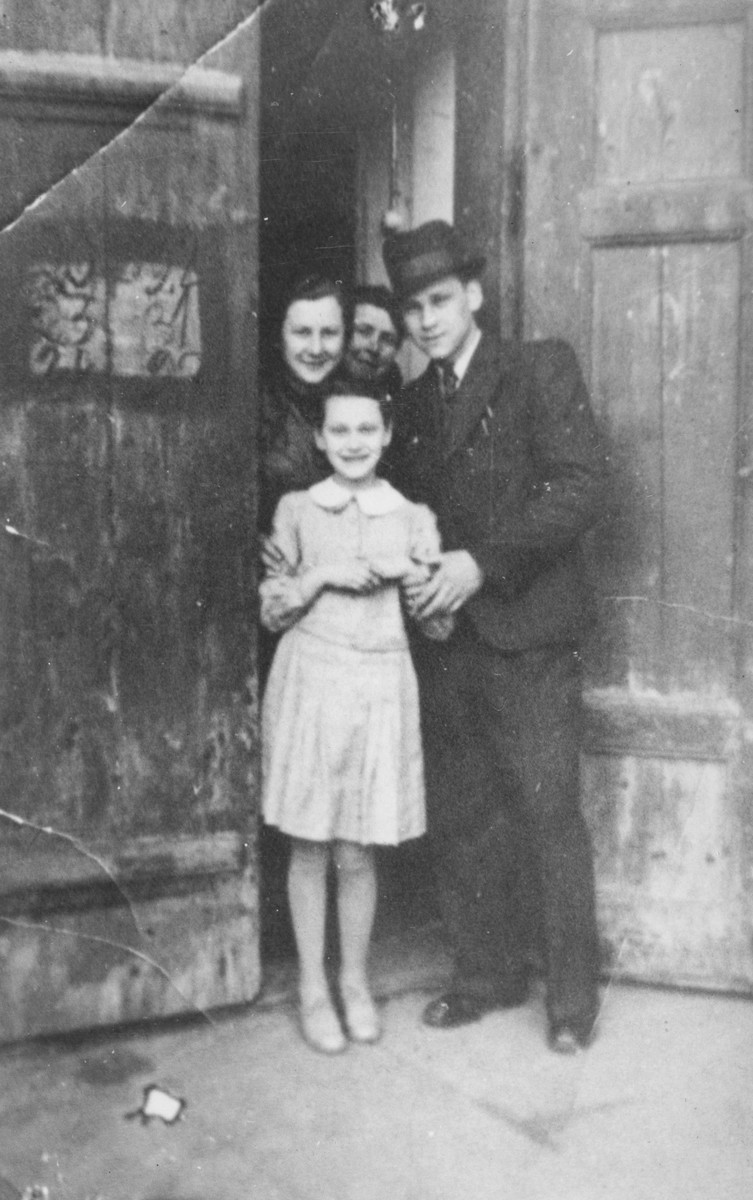 Blimcia, Aunt Esther, Vrumek and Helcia Stapler stand in the doorway of their home in the Chrzanow ghetto.