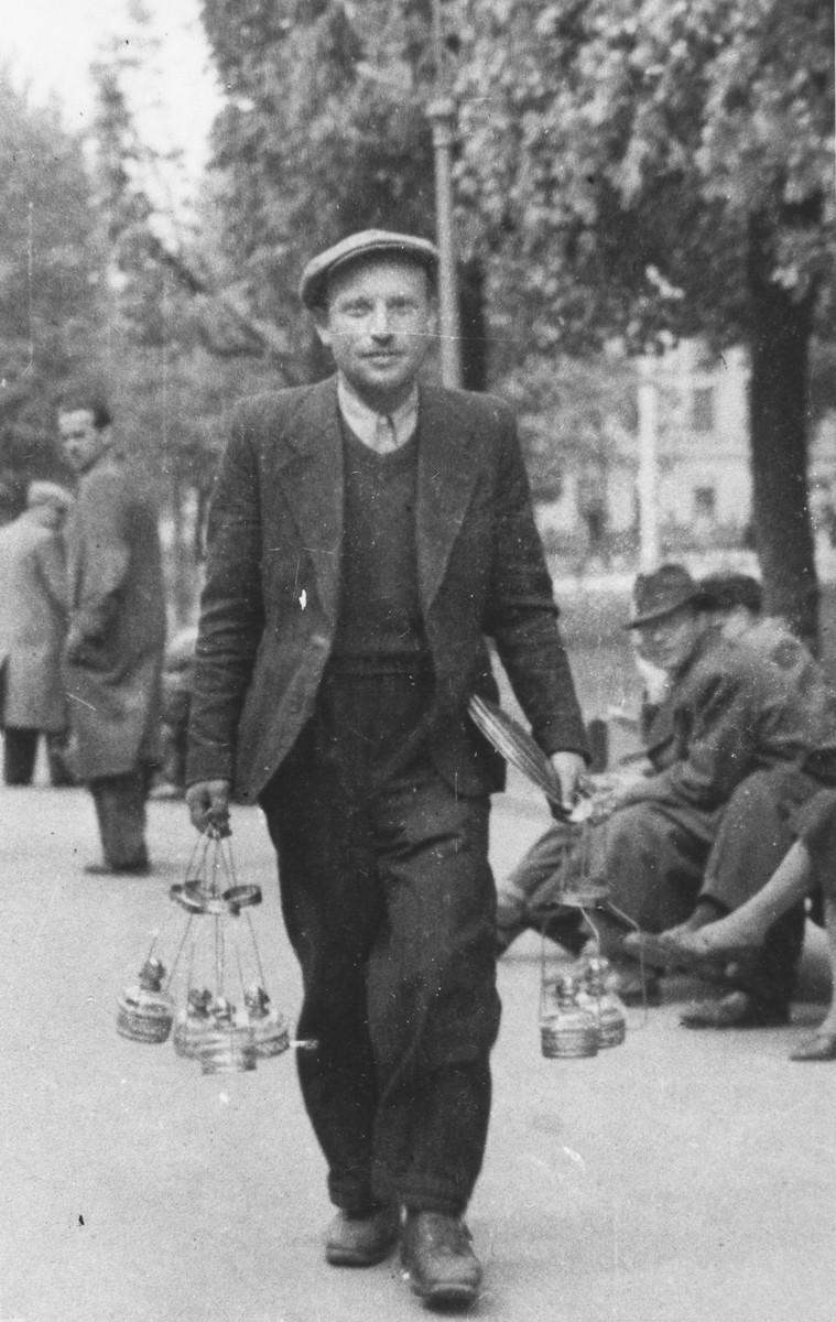 Heshek Stapler carries several kerosene lamps to sell at the black market in Lvov.