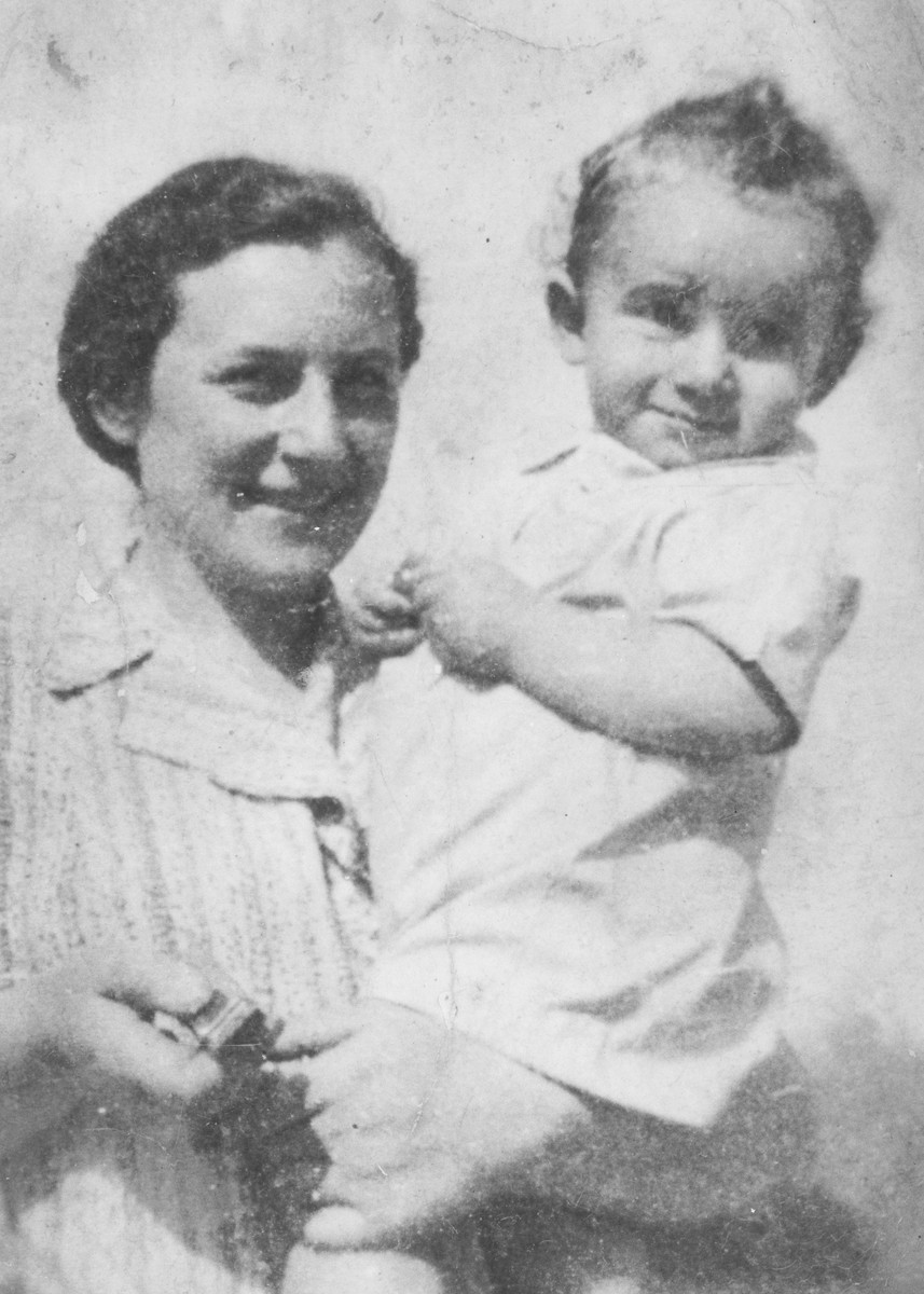Blimcia (nee Stapler) Rauchwerger holds her baby son Aizek.  She gave birth to him in the ghetto and they perished three years later in Auschwitz.