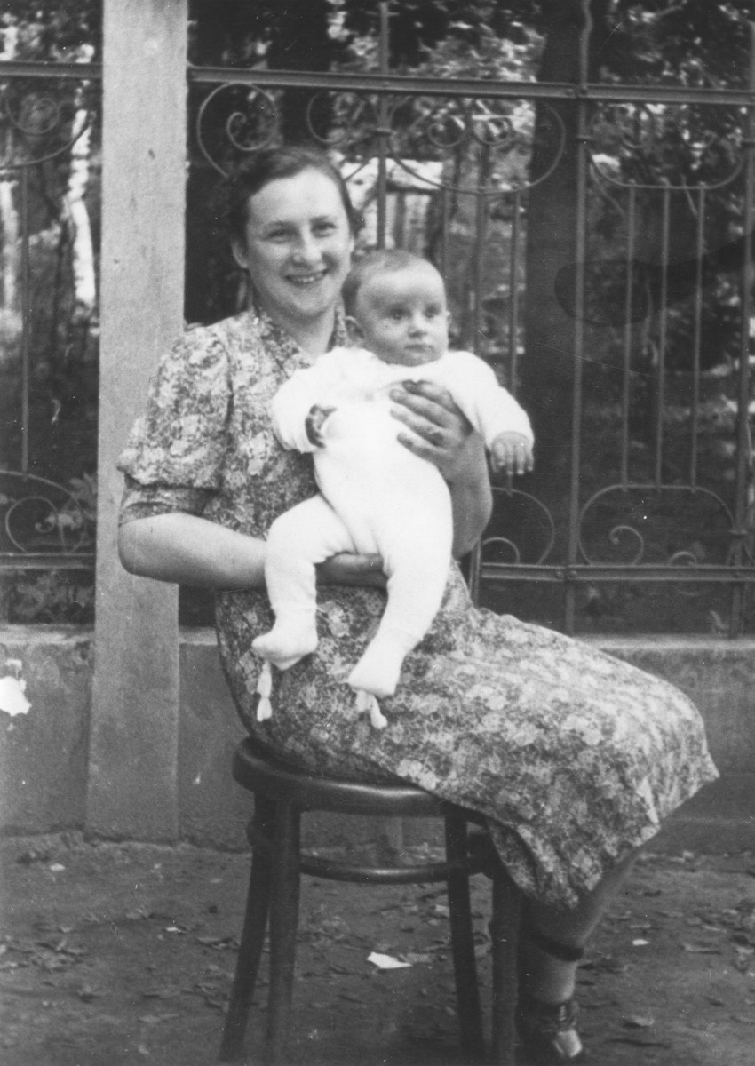 Blimcia (nee Stapler) Rauchwerger holds her baby son Aizek two years before they both perished in Auschwitz.