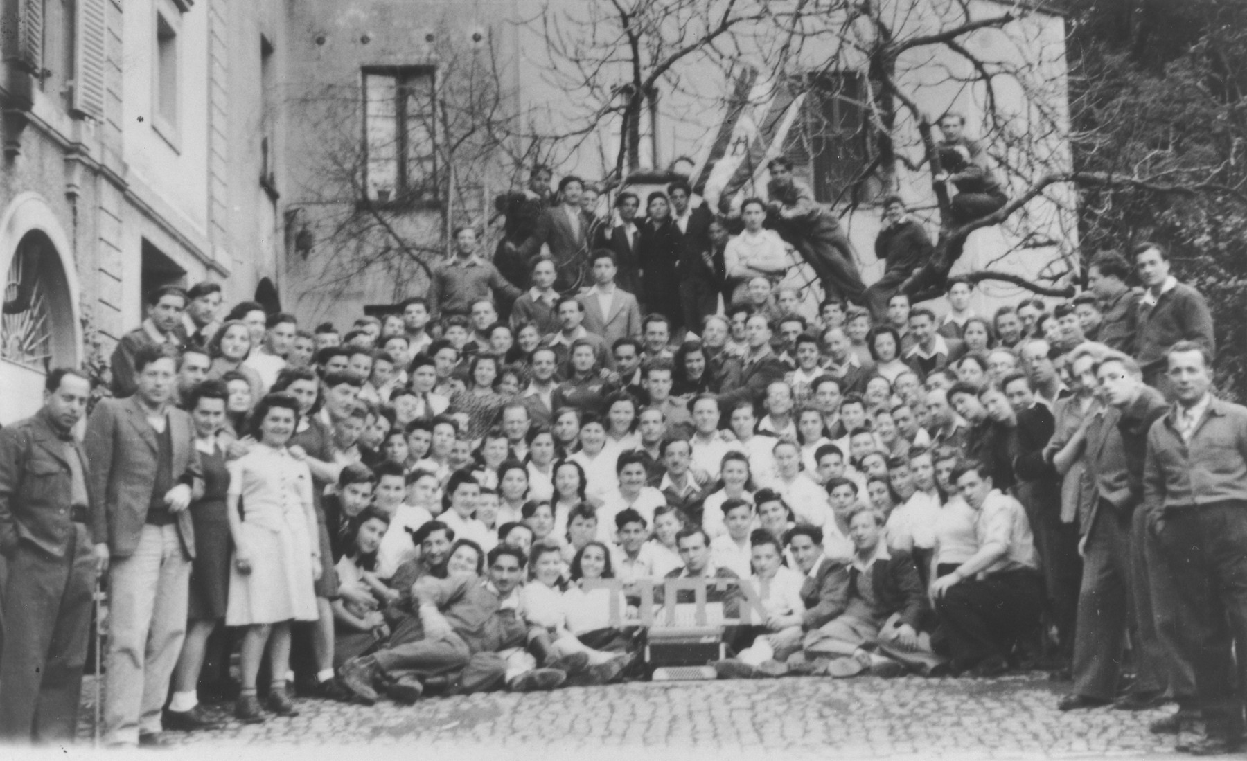 Group portrait of members of Kibbutz Ichud prior to their hunger strike in La Spezia harbor.  Among those pictured are Helcia and Nachcia Stapler.