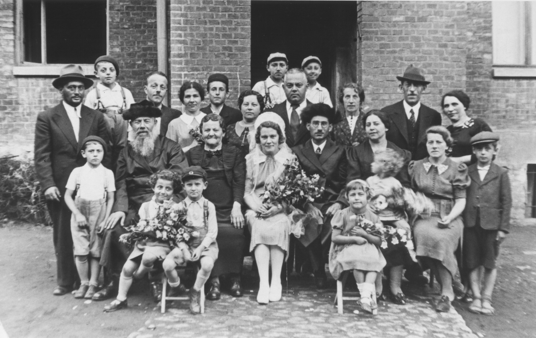 The Bachner family poses for a group shot at the wedding of Rifcia Bachner and Maier Taus.    Channa Bachner perished along with her seven children and twenty-six grandchildren in Auschwitz.