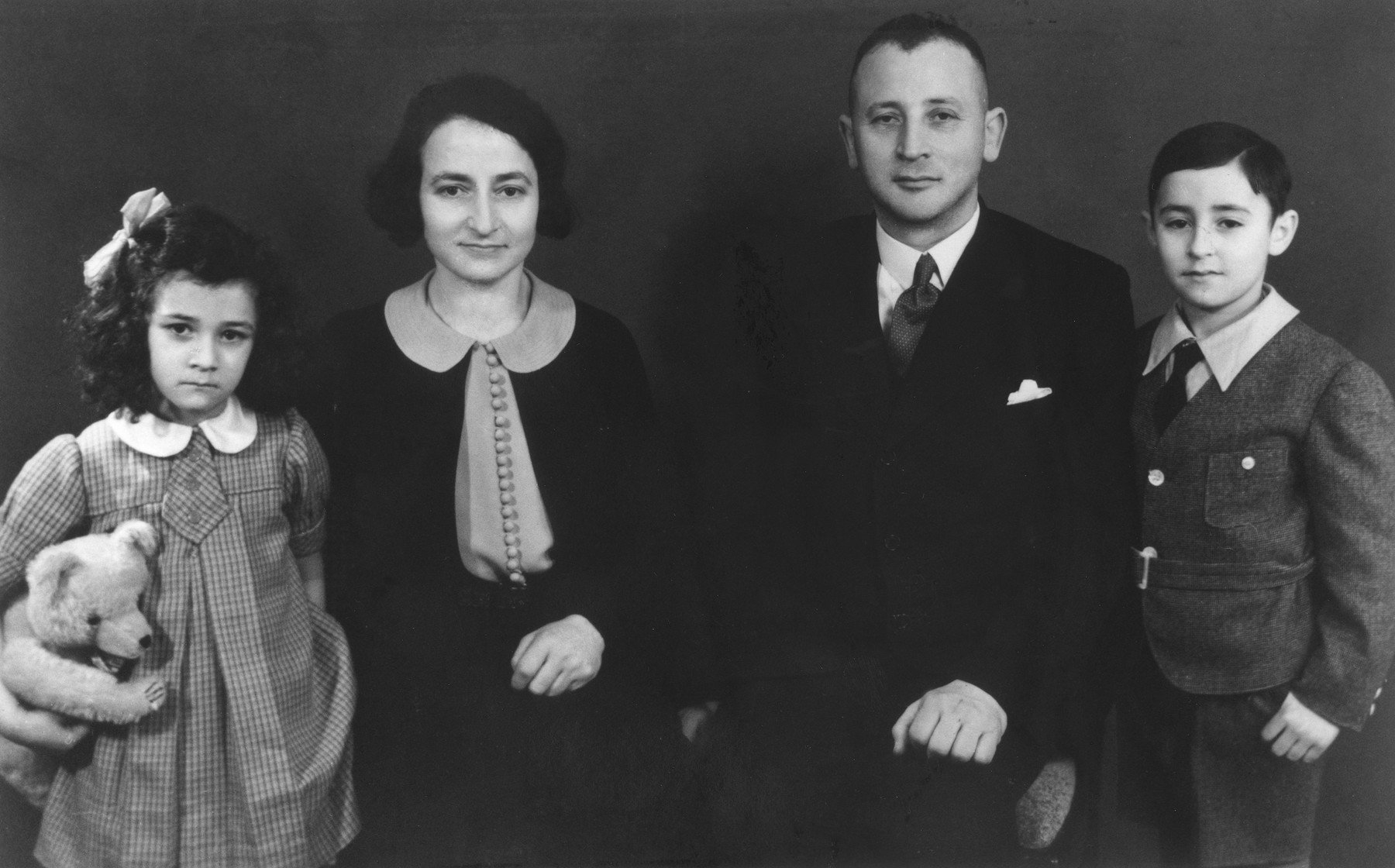 Studio portrait of the family of Leopold and Bella Loeb.  Pictured from left to right are: Ruth, Bella, Leopold, and Armin Leopold.