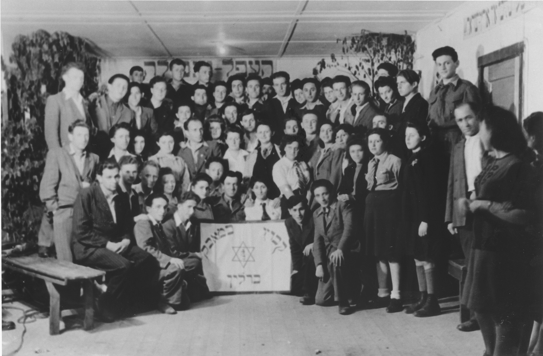 Group portrait of members of Kibbutz Be-Maavak [literally, the Kibbutz in struggle] in the Schlachtensee displaced persons camp.
