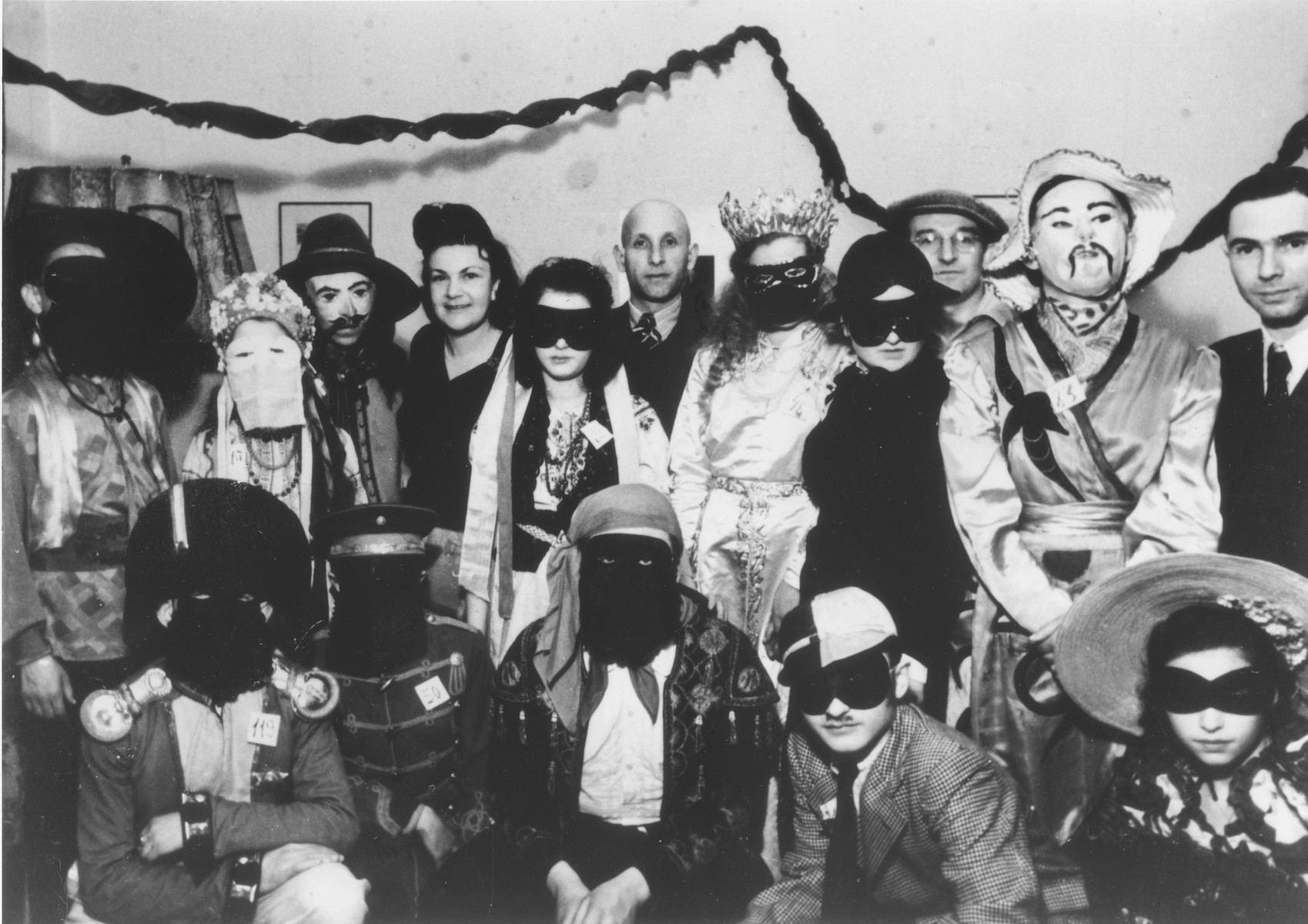 Group portrait of Jewish DPs dressed in Purim costumes at the Schlachtensee displaced persons camp.