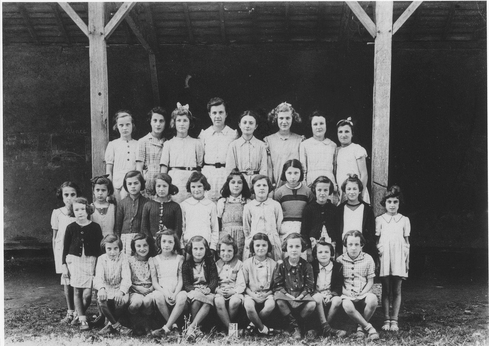 Jewish refugee children pose with their French classmates at a village school in Eauze, France.  Among those pictured are Berthe Silber (second row, second from the left); and Edith Steinfeld (standing third from the right).  Edith was subsequently deported to Auschwitz on convoy #29 from Drancy.