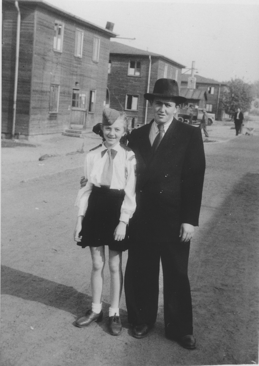 Yeshayahu Zycer (right) poses with a young girl, who is a member of the Betar Zionist youth movement, on a street in the Schlachtensee displaced persons camp.
