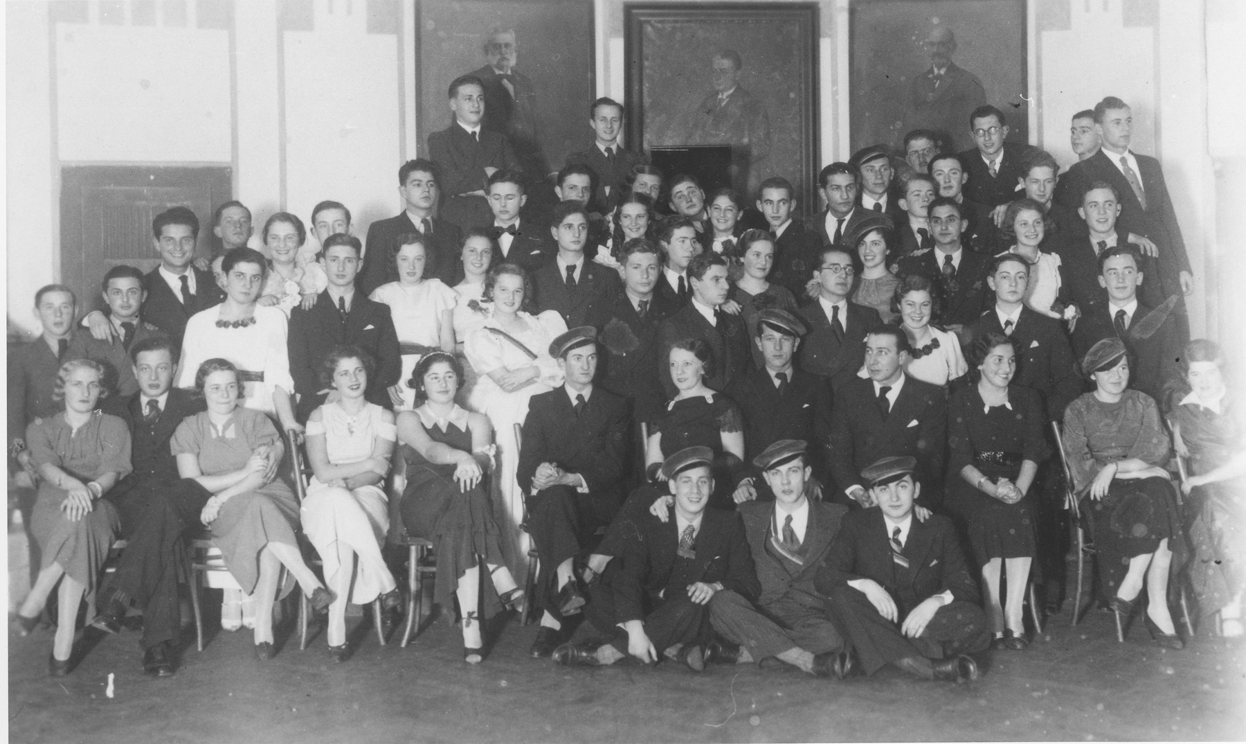 Members of the Jewish Hasmonea fraternity in Czernowitz.  There were four or five Jewish fraternities in the area, including Hebronia and Kadima.  Among those pictured, in the front row seated on chairs are:  Lotte Gottfried (far left); Joszi Krauthammer (second from the left); Hedwig Langhaus Brenner (third from the left); Herbert Gabor (sixth from the left); Jusiu Nagel (eighth from the left); Kaethe Zallik (tenth from the left); Heinrich Teitler (in the row behind and to the right of Nagel); Gerhard Krauthammer (top row, far right).