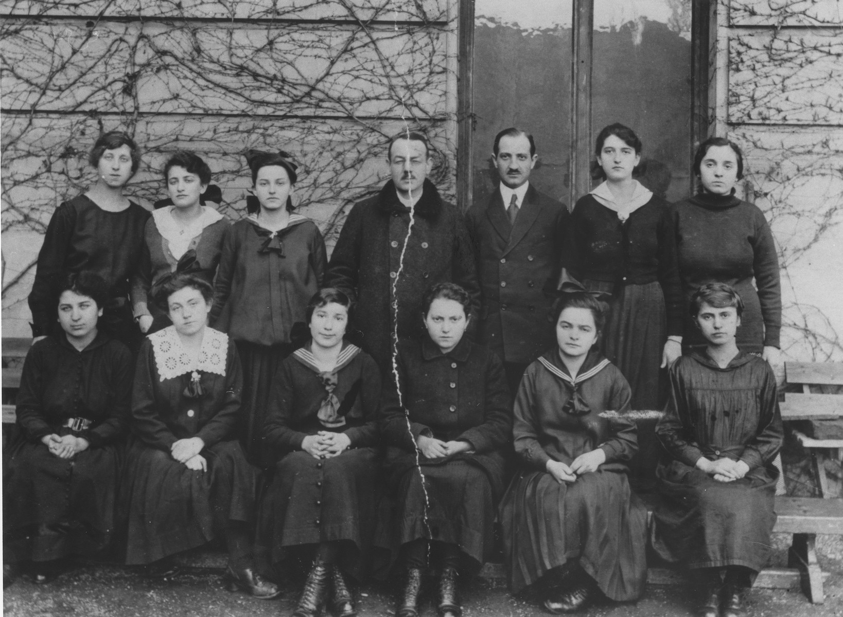Friedricke Gottfried with her graduating class at the Deutsche Lyceum in Czernowitz.  Among those pictured are Hansi Lifschitz (front row, left); Irma Last (front row, second from the right); Professor Theodor Kern (top row, center); and Friedricke Gottfried (top row, second from the left).