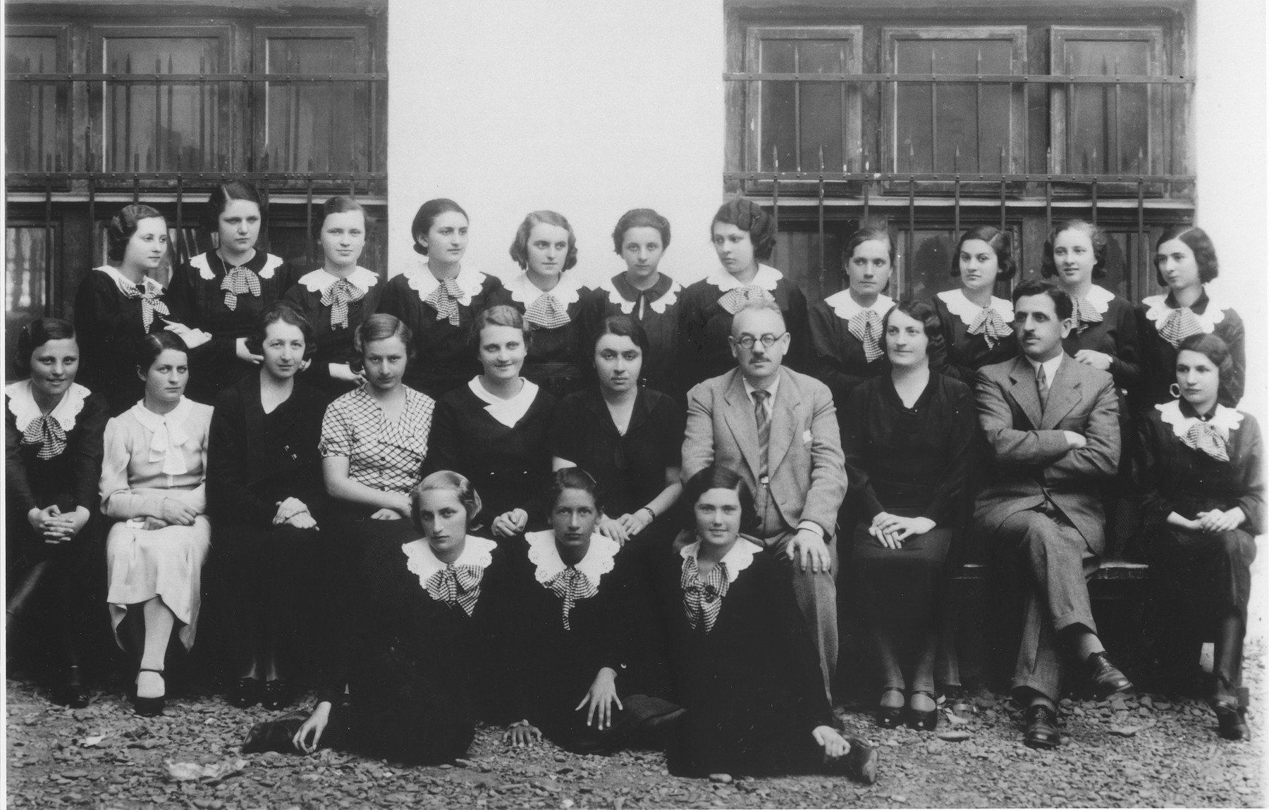 Lotte Gottfried (front row, left) with her classmates at the Hoffman gymnasium in Czernowitz.    Also pictured is Professor Theodor Kern (second row, fourth from the right).
