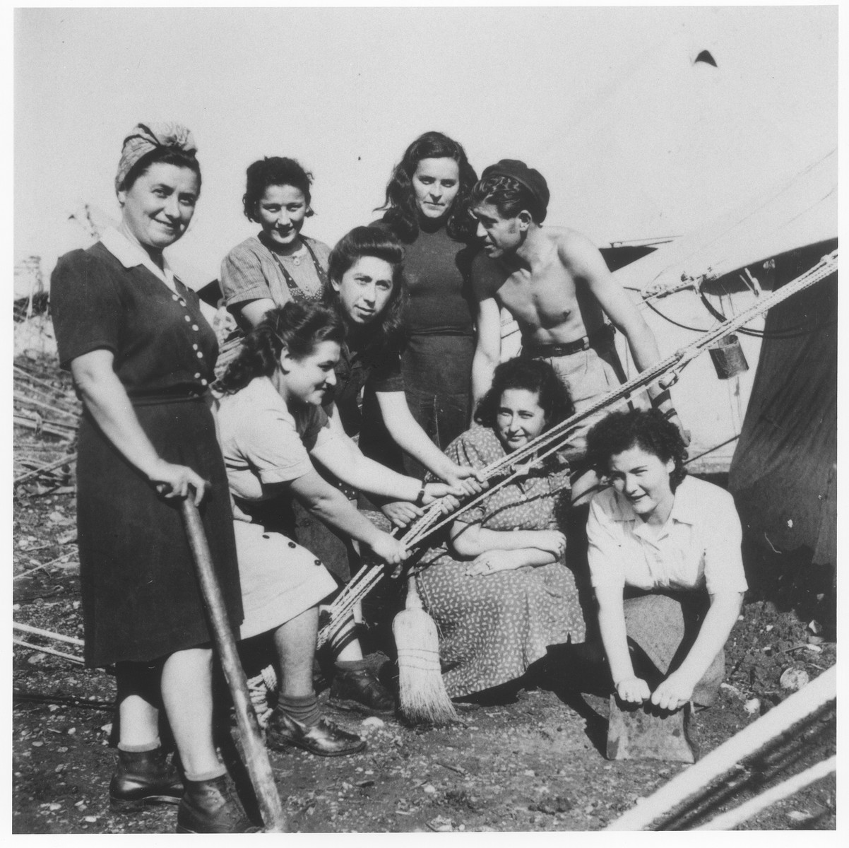 A group of young Jewish DPs pitch a tent in one of the detention camps on Cyprus.  Pictured from left to right are Malka ?, Pnina Halpern, Henchi Hellman, Rachel ?, Malka Hus, Richie Strasser and Leah Halpern.