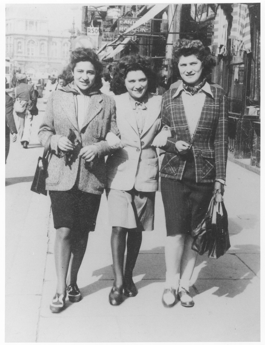 Ida Soldinger (center) walks along a street in Brussels with friends shortly before her deportation to Auschwitz via the Mechelen transit camp.