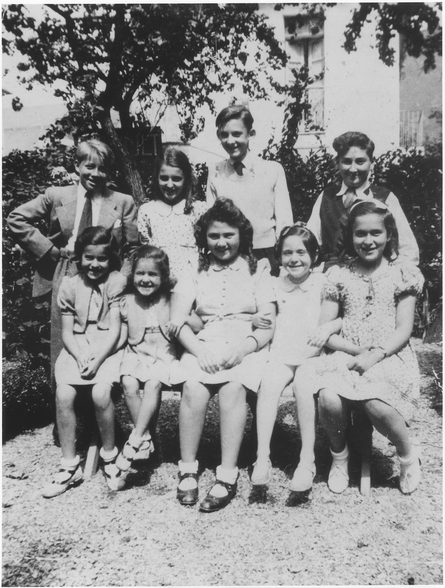 Group portrait of Belgium Jewish refugee children in Luchon, France.  Pictured in the front row from left to right are Berthe and Sara Silber; Rachel Tyberg; Lucy Schifmanovitch; and Gisele Cohen.  Standing in the back row at the right is Abraham Tyberg.