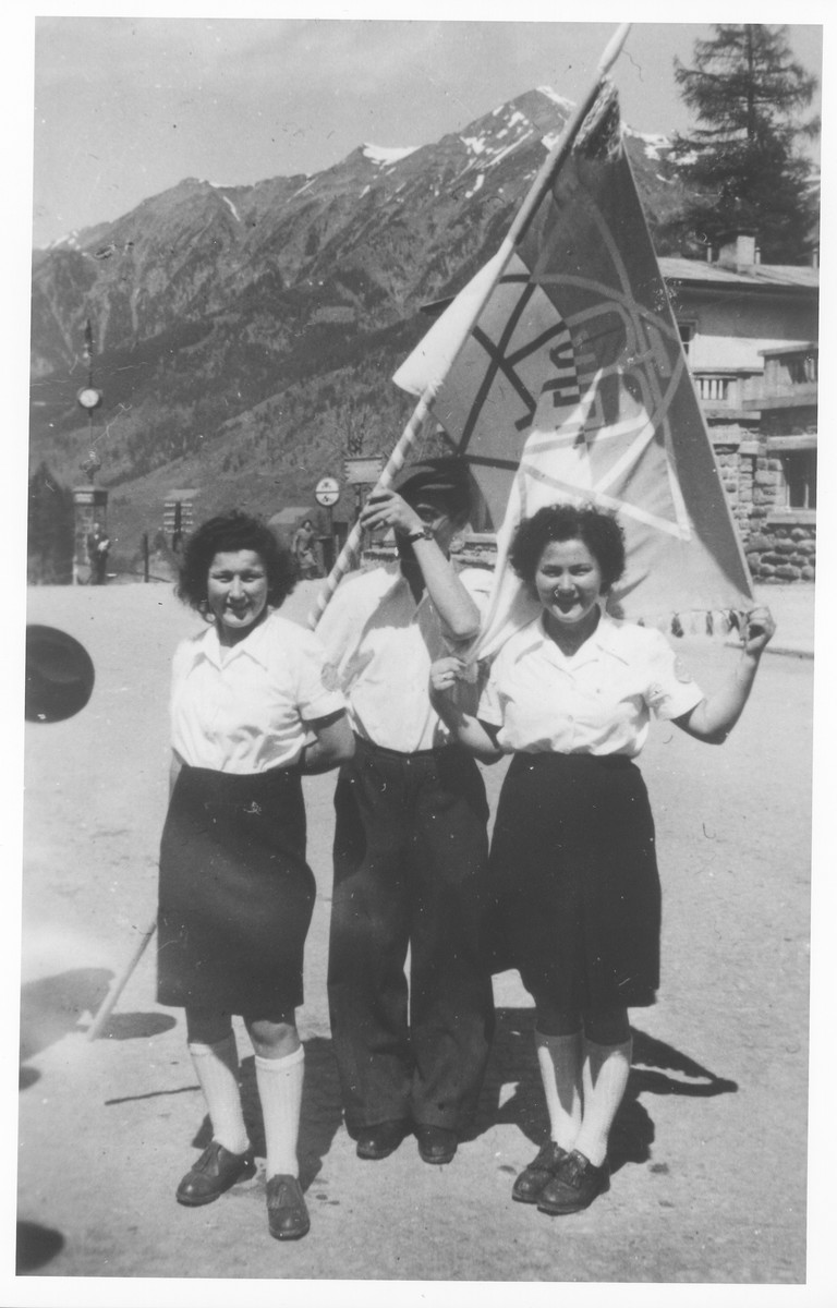 Three Jewish DPs pose with a Zionist flag in the Bad Gastein displaced persons camp.  Pictured from left to right are Pnina, Meir and Leah Halpern.