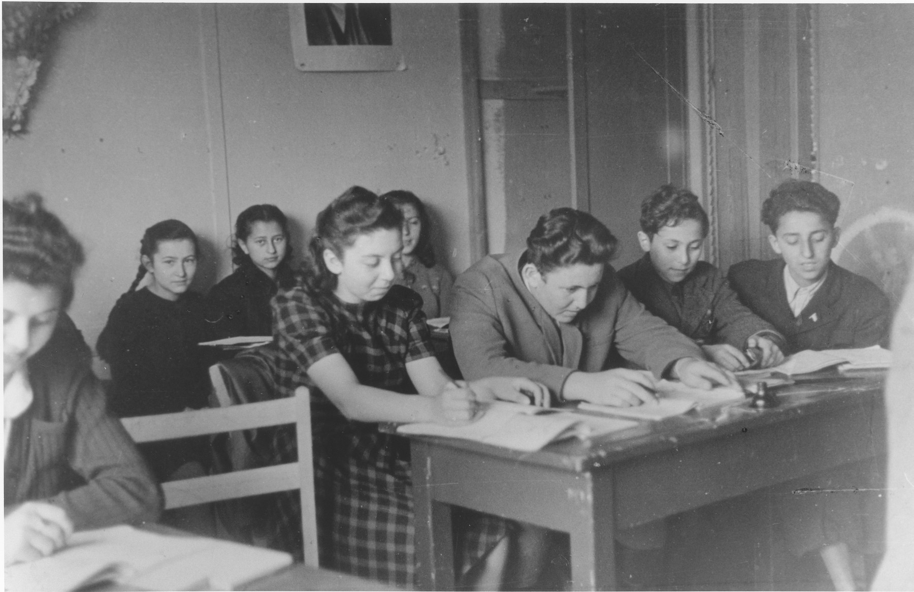 High school students at the Schlachtensee displaced persons camp study in a classroom.  Among those pictured is Shaya Zycer (third from right).