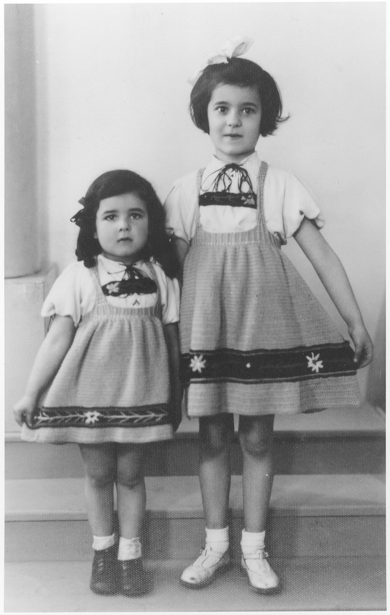 Studio portrait of Berthe and Sara Silber in matching outfits.