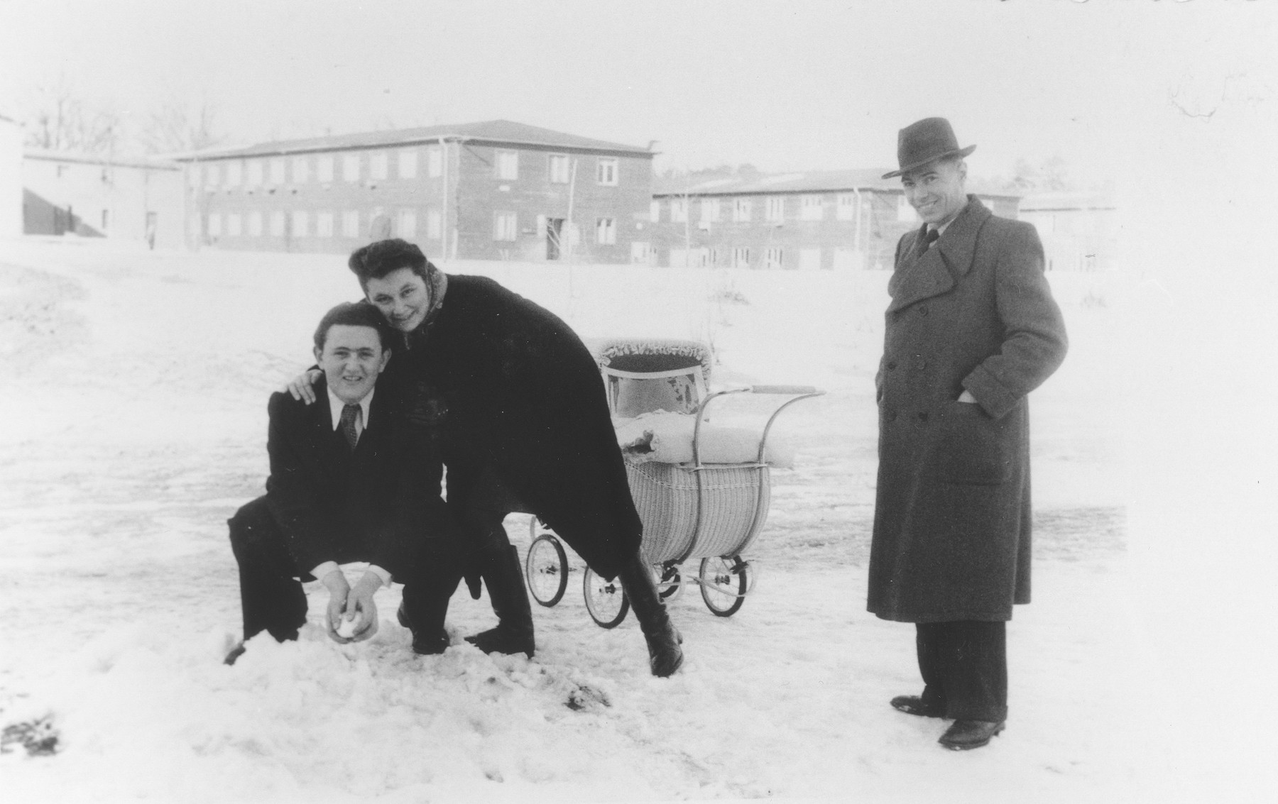 Yeshayahu Zycer plays in the snow with his teachers, Margot and Leonhard Natkowitz, at the Schlachtensee displaced persons camp.