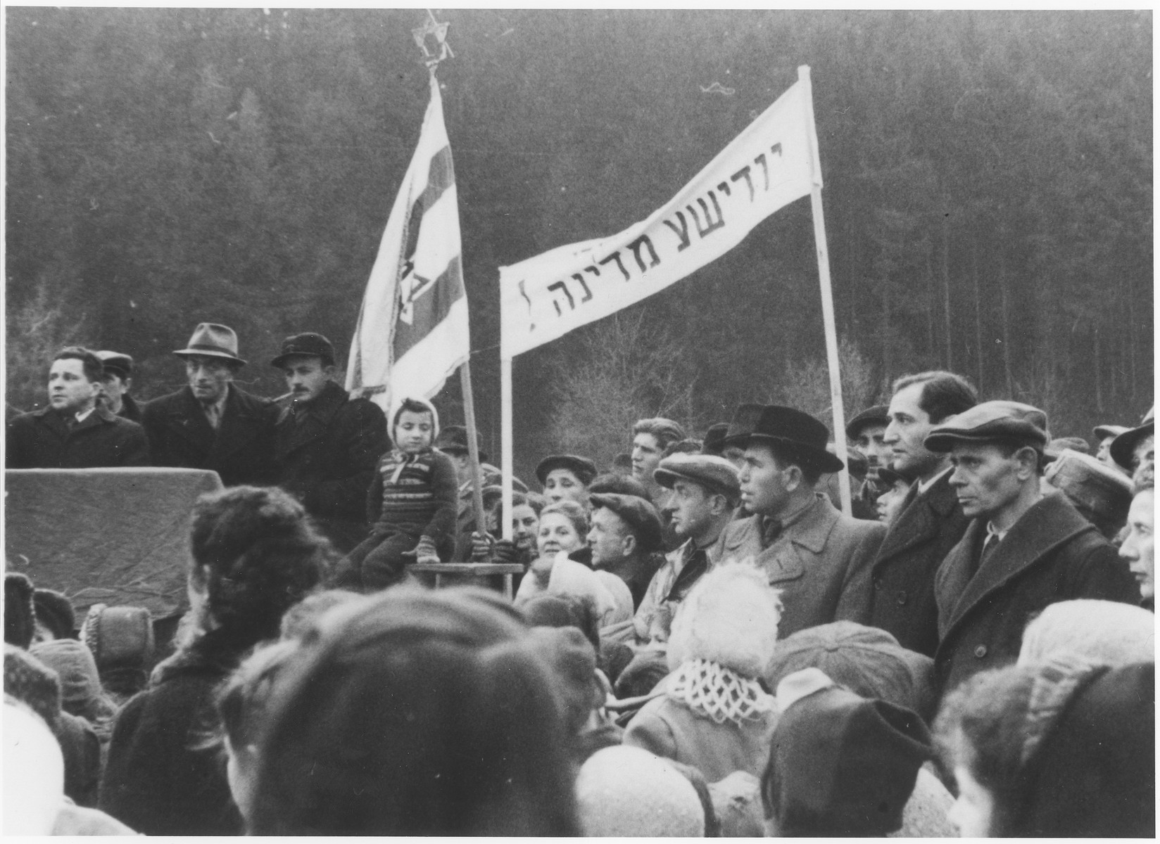 "Jewish DPs attend a political demonstration in the Wetzlar displaced persons camp demanding the establishment of a Jewish state in Palestine.    The Yiddish banner reads ""Jewish state""."