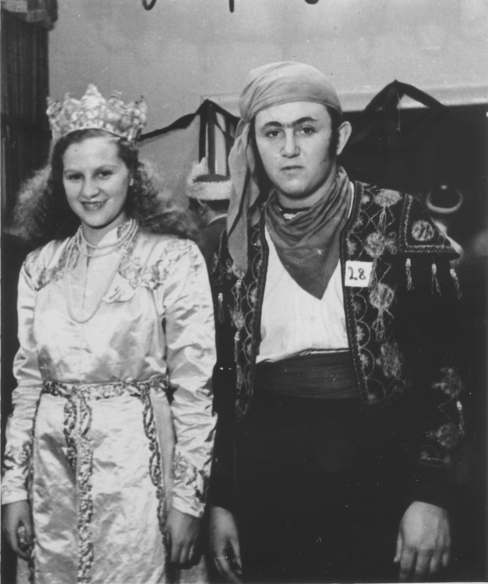 Yeshayahu Zycer poses in Purim costume with Luba Kerschenblat at the Schlachtensee displaced persons camp.