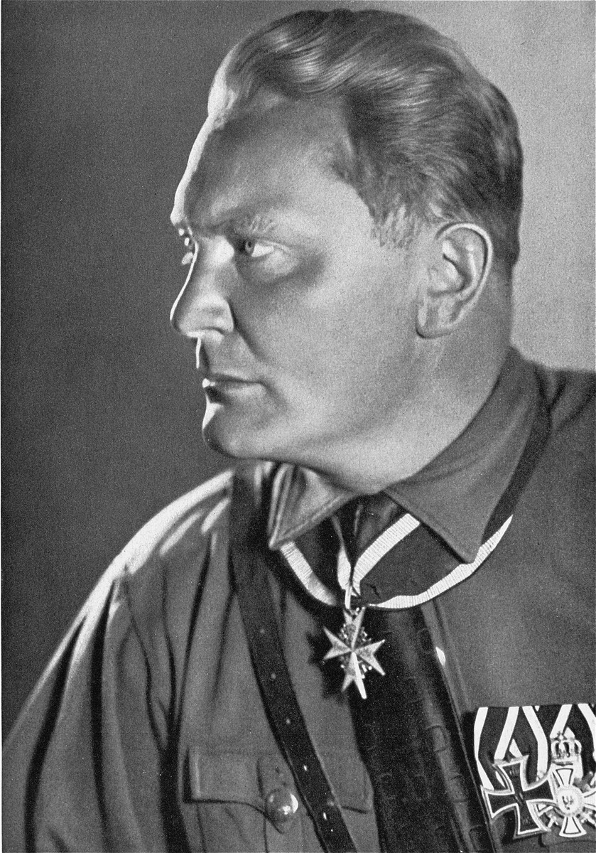 "Portrait of Hermann Goering.  Hermann Goering (1893-1946), was Commander-in-Chief of the Luftwaffe, President of the Reichstag, and initially Hitler's chosen successor.  He first gained recognition as a World War I fighter pilot.  He joined the NSDAP in 1922 and participated in the Beer Hall Putsch in 1923.  He became a valuable asset to Hitler, using his connections in the army and business to gain support for the NSDAP.  Upon Hitler's appointment to the chancellorship, Goering was rewarded with high positions, including Commander-in-Chief of the Prussian Police and Gestapo, and Commissioner for Aviation.  Goering set up the first concentration camps and organized the Gestapo with Heinrich Himmler and Reinhard Heydrich.  In 1935 he was appointed Commander-in-Chief of the Luftwaffe and in 1936, Plenipotentiary of the Four Year Plan.  In the aftermath of Kristallnacht, it was Goering who instructed Heydrich to prepare a ""General Solution"" to the Jewish problem.  In June 1940, Goering was named Reich Marshal, a special position, reflecting Hitler's high regard for him.  However, after the defeat of the German Luftwaffe in the Battle of Britain, Goering's influenced waned.  Following the German surrender, Goering was captured and put on trial in Nuremberg.  He emerged as the dominant figure among the accused Nazis, sometimes successfully defending himself against the accusations of the prosecution.  Nevertheless, he was convicted and sentenced to death.  On October 15, 1946, just two hours before his scheduled execution, he committed suicide by swallowing a cyanide capsule he managed to smuggle into prison."