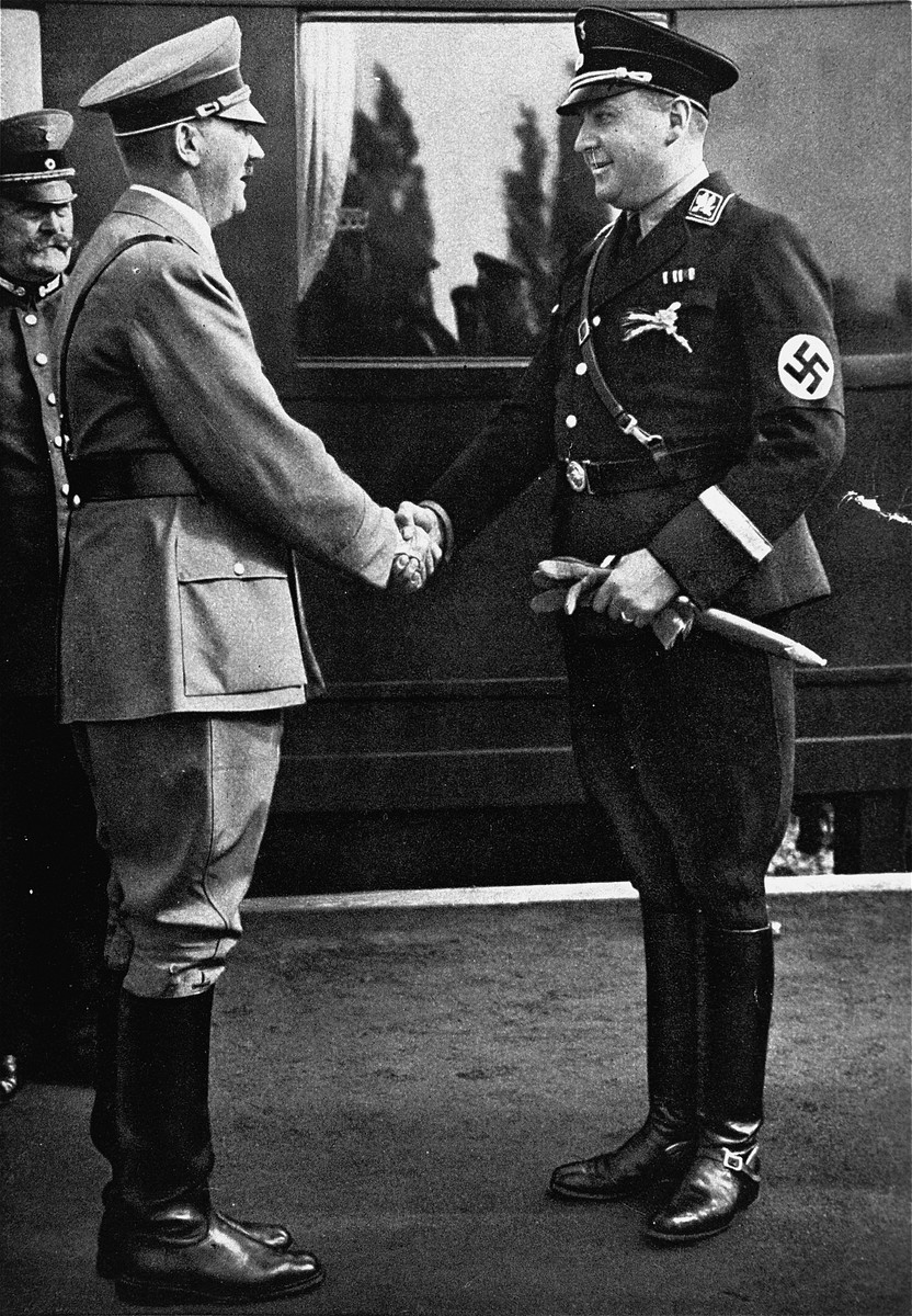 Reich Minister Richard Walther Darre greets Hitler at the train station at the time of the harvest festival.  [Joe White has also identified this Nazi official as Kurt Daluege (Chief of the Ordnungspolizei)]