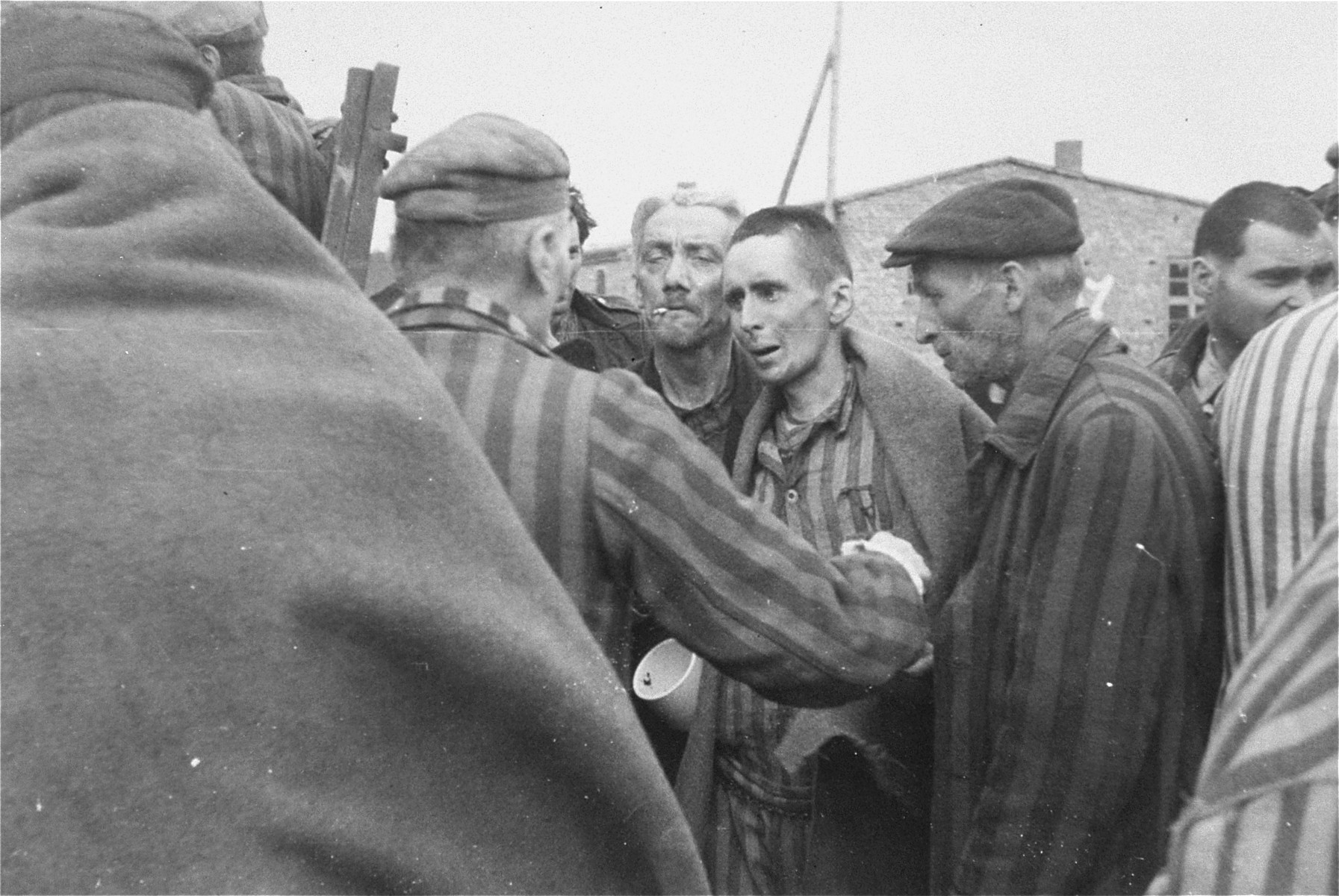 Survivors in Woebbelin board trucks for evacuation from the camp to an American field hospital for medical attention.