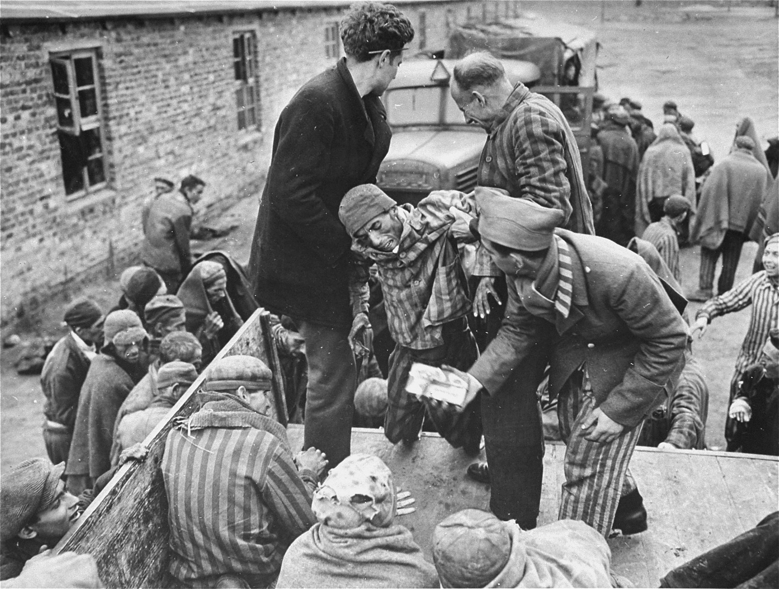 Sick survivors are evacuated from the Woebbelin concentration camp to an American field hospital where they will receive medical attention.