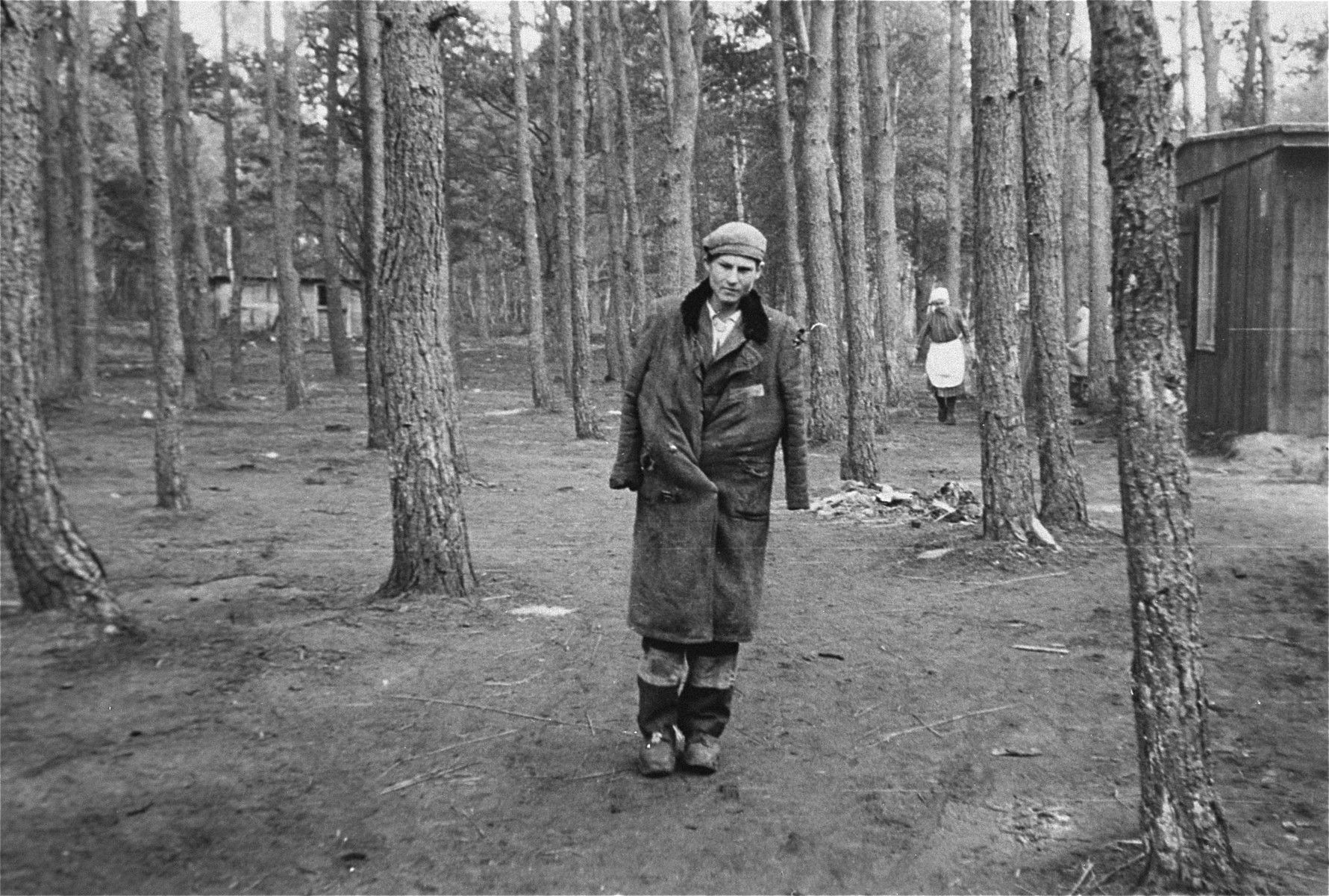 A survivor in Woebbelin who is standing just outside of the women's camp.