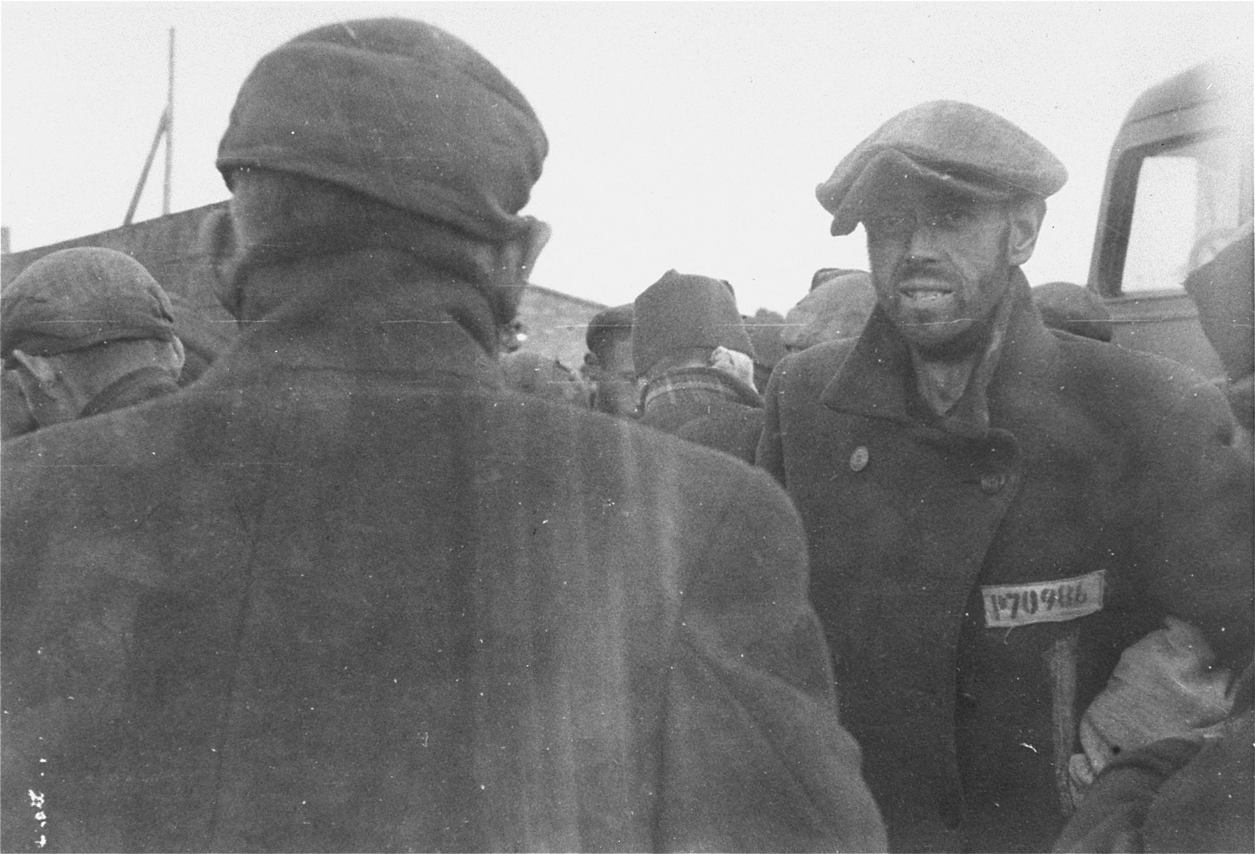 Survivors in Woebbelin wait to be evacuated to an American field hospital for medical attention.