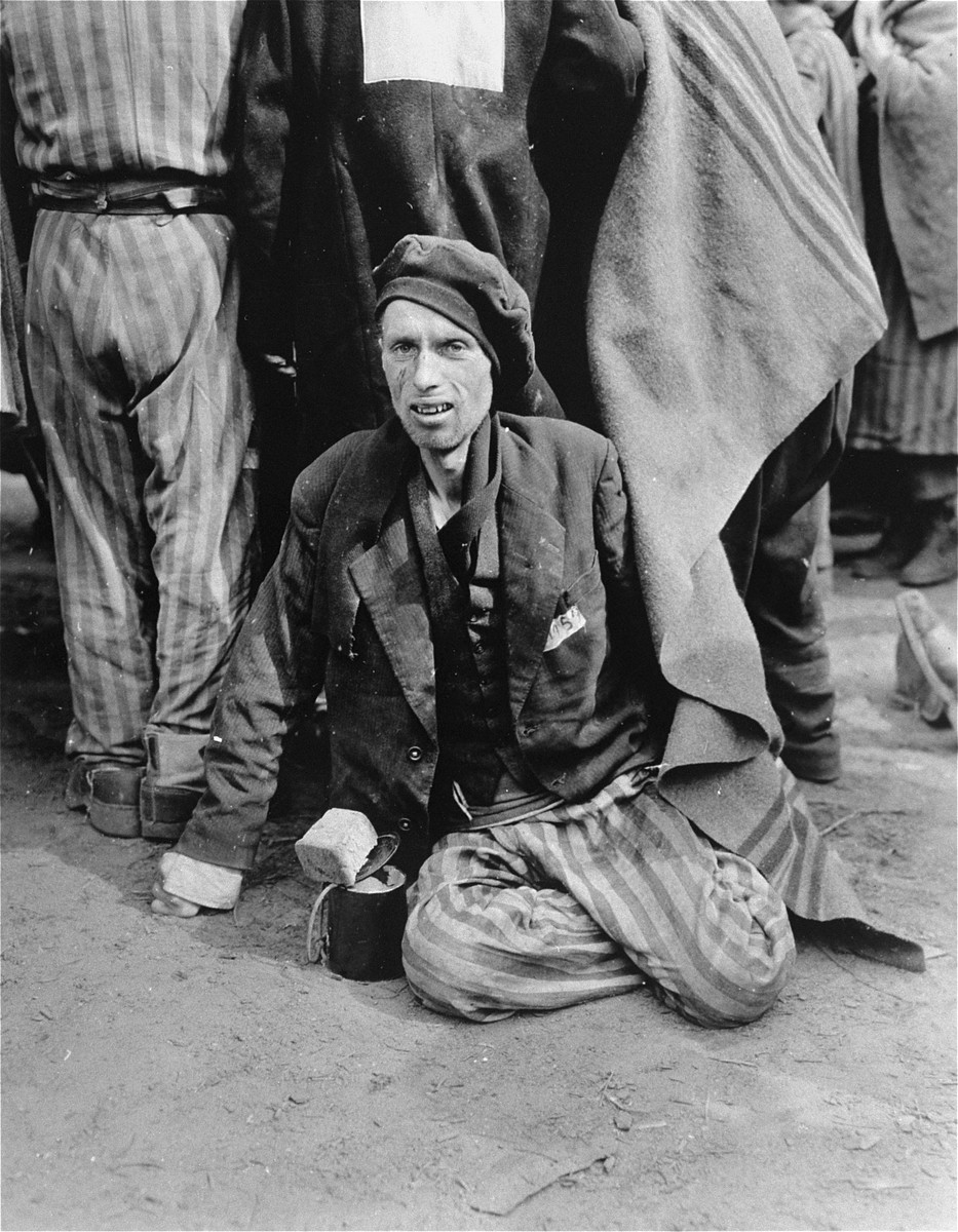 An emaciated survivor waits for evacuation from the Woebbelin concentration camp to an American field hospital.