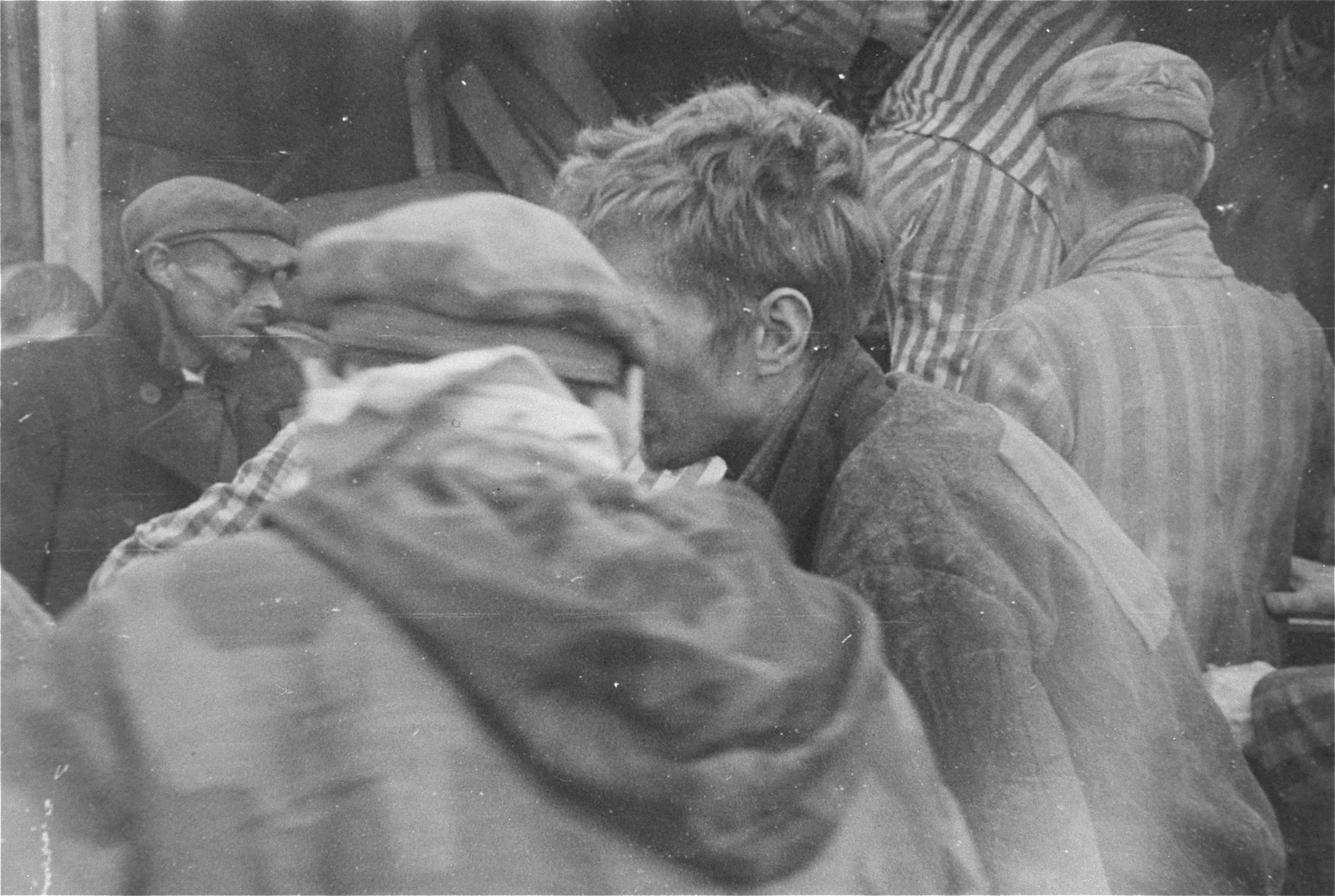 Survivors are evacuated from the Woebbelin concentration camp to an American field hospital where they will receive medical attention.