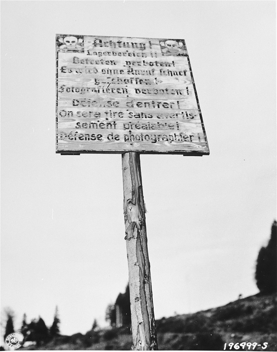 A sign on the road to the Natzweiler-Struthof concentration camp warning that the camp is in the area and that those who approach it will be shot without warning.
