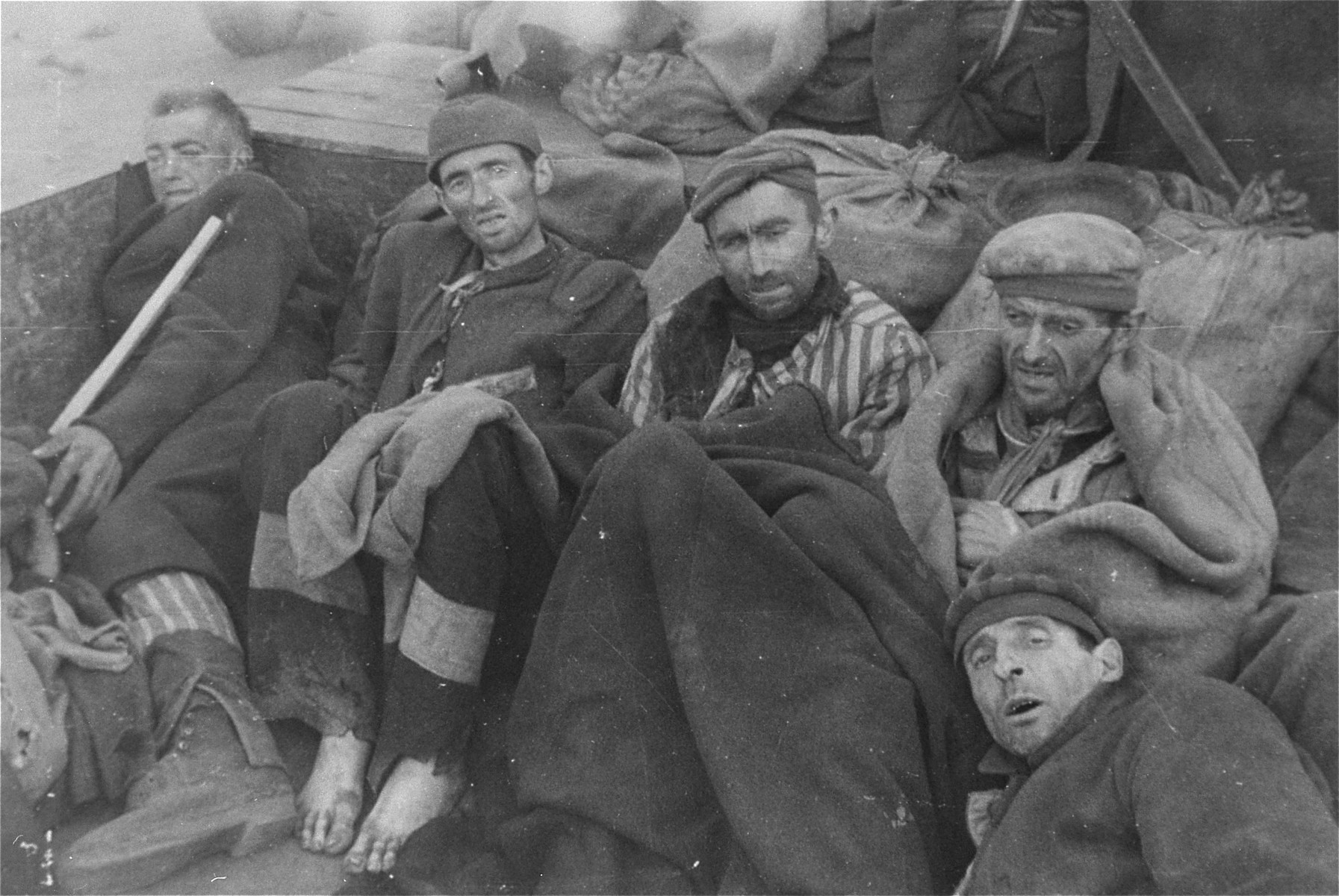 Survivors in Woebbelin wait for evacuation to an American field hospital, where they will receive medical attention.