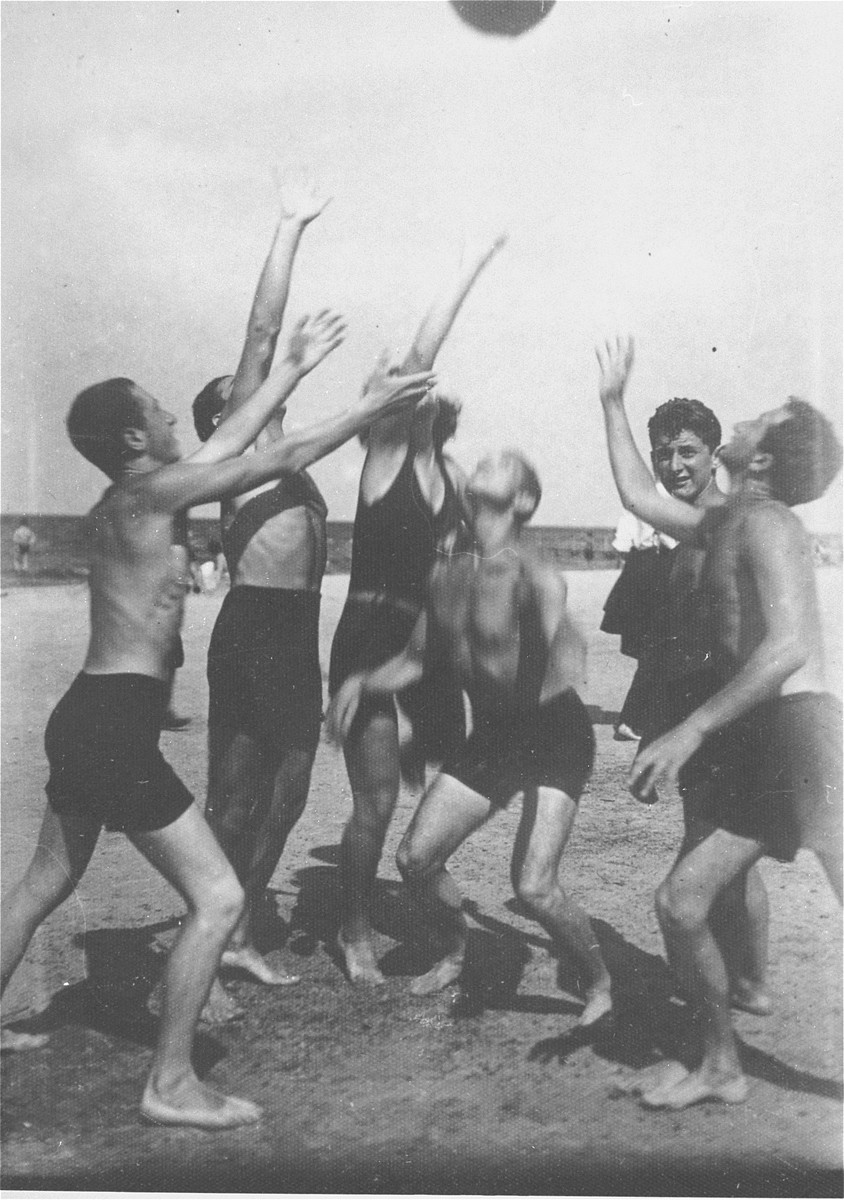 Jewish youth play a game of ball on a beach in Riga.