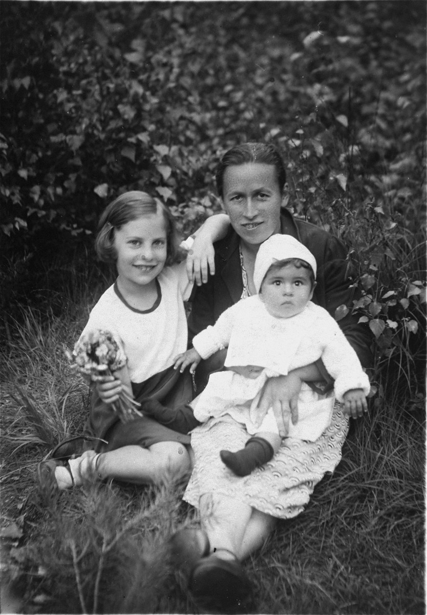 Sia and Margo Izrailewitsch with their nanny, Praskovia Rylski.    The nanny kept the family photographs during the war and returned them to Sia and her father, Reuven, after their return to Riga after the war.