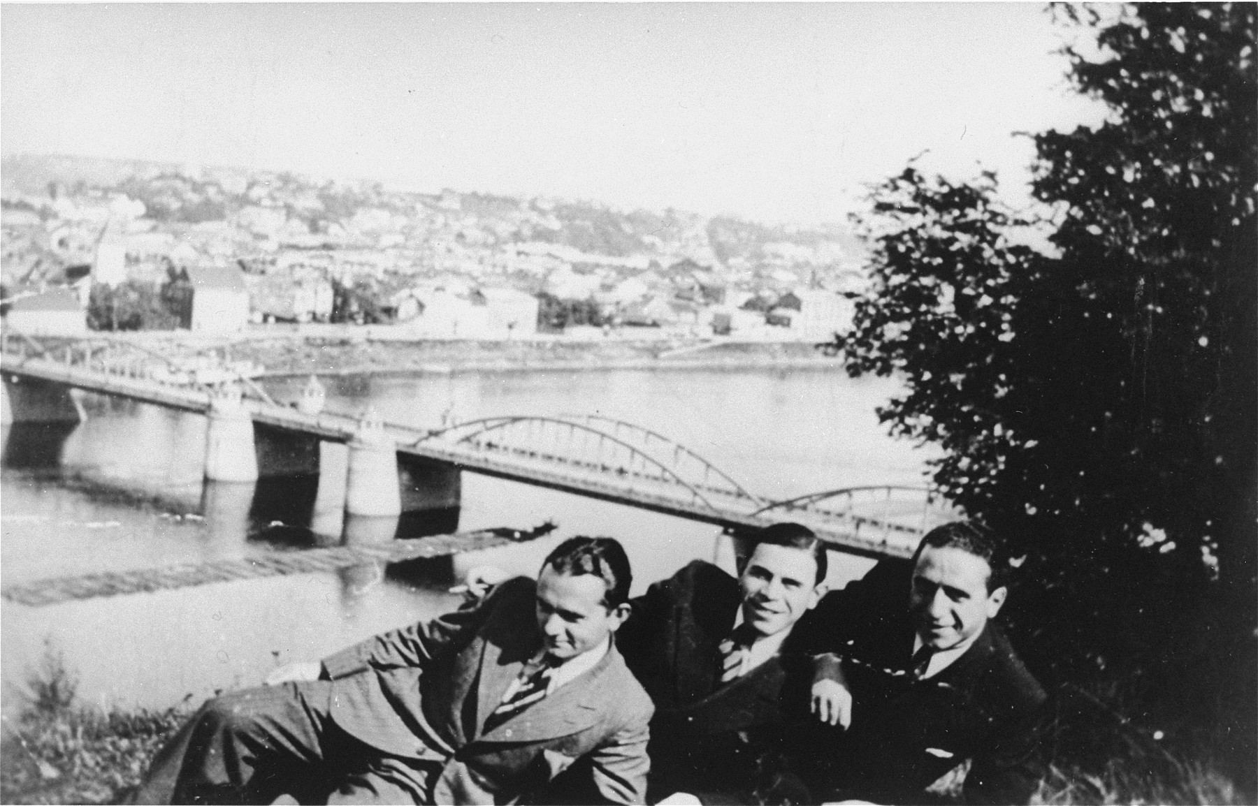 Three Jewish friends pose for a picture on the banks of the Nemanas River in Kovno.    Pictured from left to right are: Jankel Selsky, Jona Wisgardisky (the donor's father), and Shabbtai Poner.  All three survived the war.