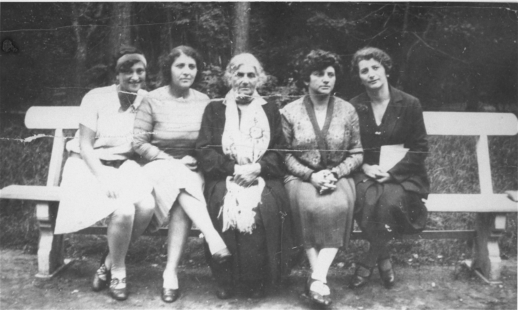 The women of the Bobrow family share a park bench in Kaunas.