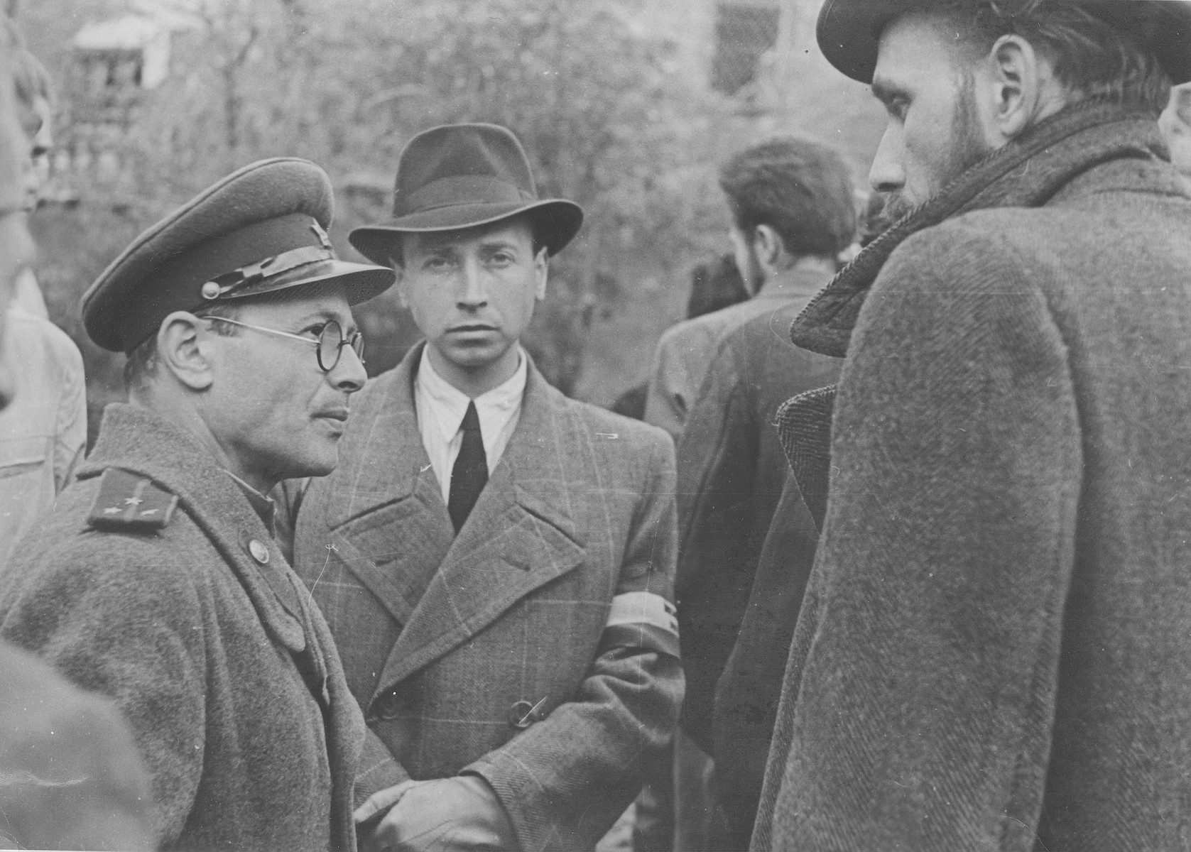 Hungarian communist officials at the site of the Maros street hospital massacre.  Pictured at the left is the photographer Sandor Ek, a Hungarian officer in the Russian Army.