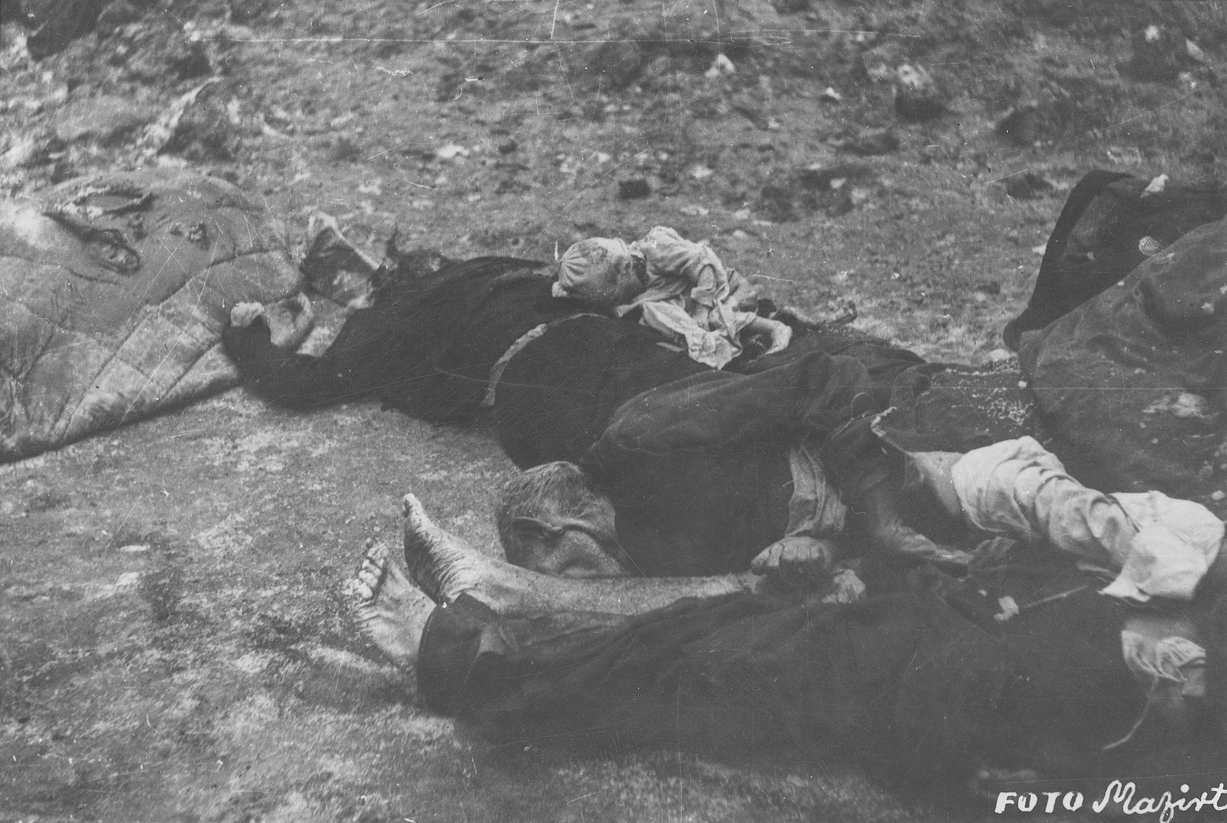 Corpses of Jews in the courtyard of the Dohany Street Synagogue.  During the last few months of the war in Hungary, the Nyilas (Arrow Cross) exploited the anarchic conditions in the areas still under their control to continue their excesses against the Jews.  This was particularly true in Budapest, despite the fact that the Soviet army had completely encircled the city by December 27, 1944.  The reign of terror that had begun with Szalaszi's assumption of power on October 15, 1944, went almost completely unchecked after the beginning of the Soviet siege on December 9.  Gangs of armed Nyilas--mostly teenagers--roamed the city hunting for Jews in hiding.  They searched them out in hospitals, shelters, homes outside the ghetto, in the International Ghetto, and in the large ghetto.  After robbing the Jews of their remaining valuables, the Nyilas shot them on the spot or marched them to the banks of the Danube, where they shot them, and threw their bodies into the river.  A large number of Jews who were murdered in the ghetto were buried in mass graves in the courtyard of the Dohany Street Synagogue.  The most horrific of these attacks occurred on the Pest side of the capital, at the two Jewish hospitals located on Maros and Varosmajor streets.  The Maros Street hospital, which had operated under the protection of the International Red Cross during the German occupation, was attacked on January 11, 1945.  After the initial melee, during which Nyilas gang members wantonly destroyed hospital equipment, threw patients out of their beds and trampled them, and murdered staff members, survivors were ordered to dig a mass grave, remove and bury the bodies.  They were then shot and buried in the grave themselves.  Only one nurse survived of the 92 people that were in the hospital at the time.  Three days later, on January 14, the hospital on Varosmajor Street was attacked, resulting in the deaths of 150 patients and medical staff.  These manhunts and massacres continued unabated