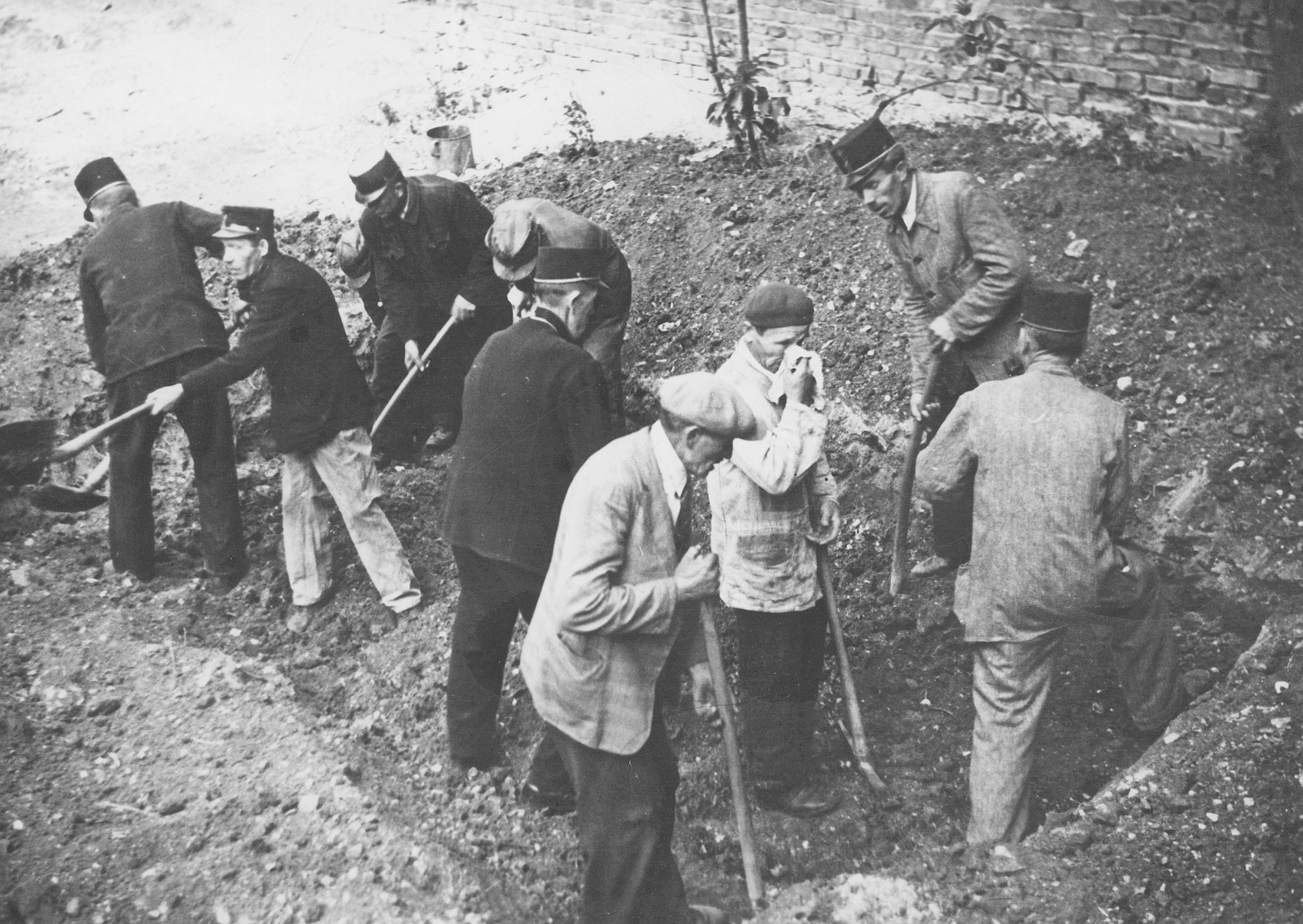 Hungarians exhume the bodies of Jews from a mass grave.  The victims were killed in the Maros Street Hospital massacre.