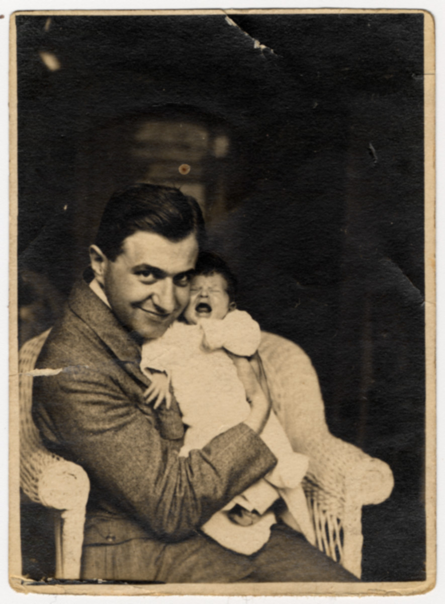 Close-up portrait of a Czech-Jewish father holding his infant daughter.  Pictured are Karel and Marietta Grunbaum.