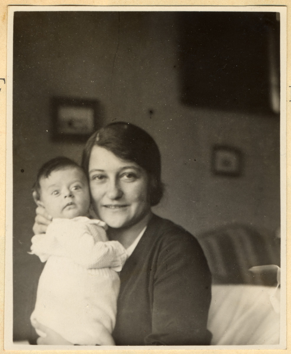 Close-up portrait of a Czech-Jewish mother holding her infant son.  Pictured are Margaret and Michael Grunbaum.