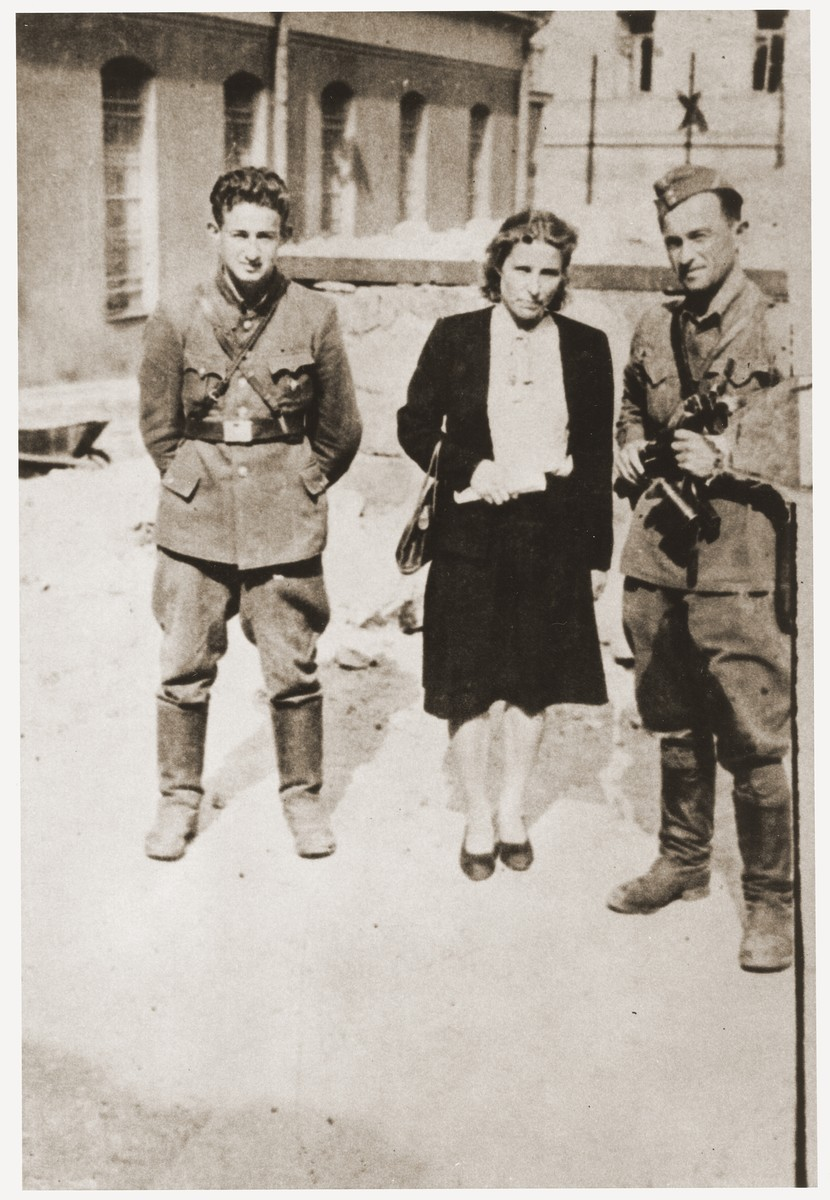 Three former Jewish partisans pose in the Vilna ghetto soon after the liberation.  Pictured from left to right are; Joseph Harmatz; Valia Pszewalska and Avraham Sabrin (the last commander of the partisan La Nitzachon battalion).